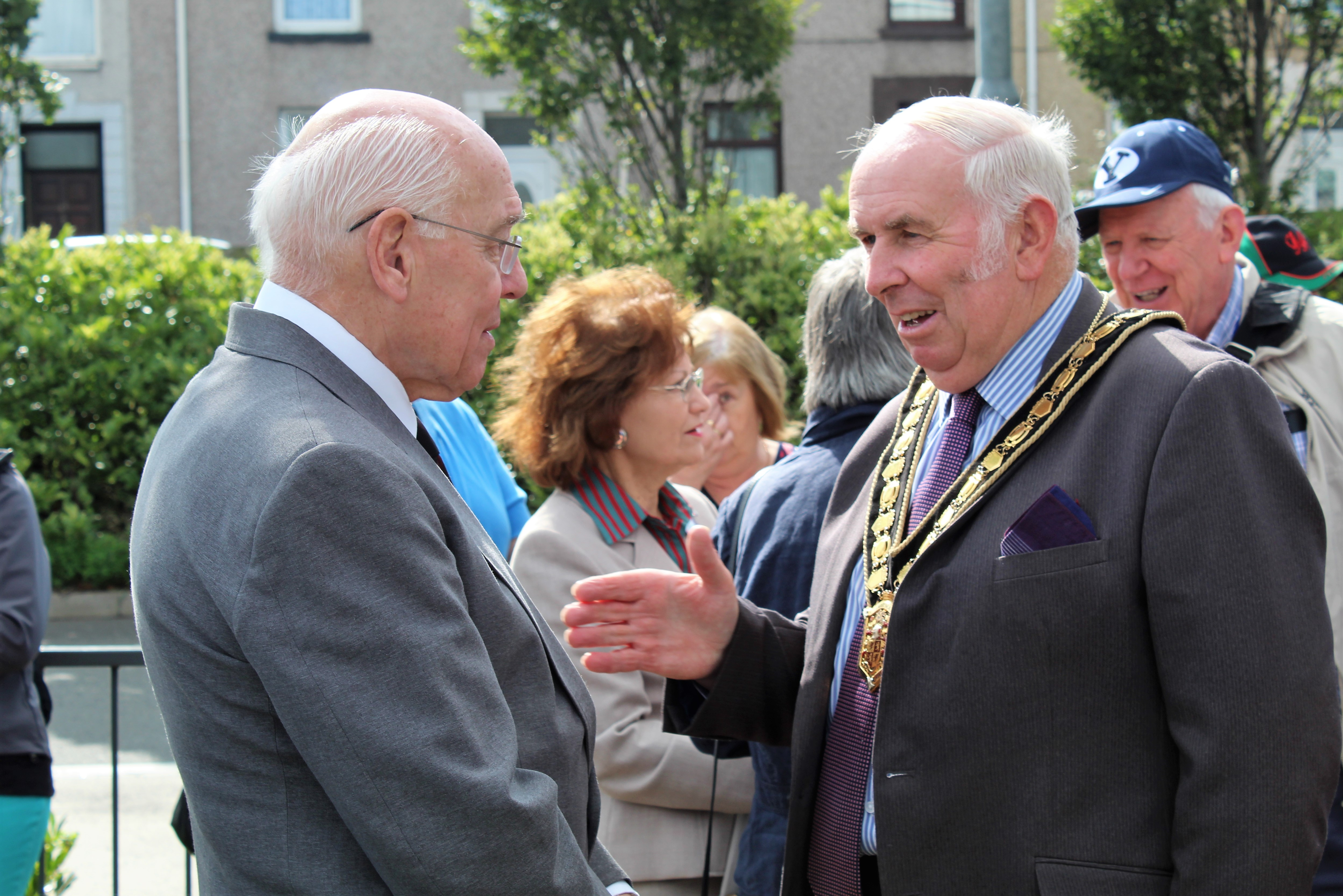 Dr. Ronald Dennis (left) speaks with the Chair of the Carmathenshire County Council, Councilor Mansel Charles, Plaid Cymru of Llanegwad, following the Island Place Meeting House plaque unveiling on Aug. 25, in Llanelli, Wales.