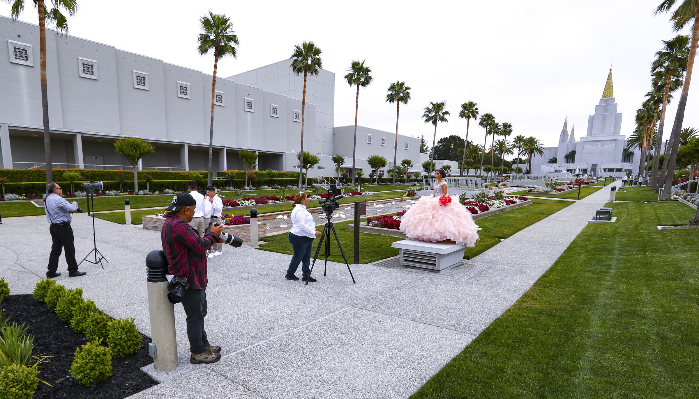 With the Oakland California Temple as a backdrop photographers take quinceanera photos on the grounds on Friday, June 14, 2019.