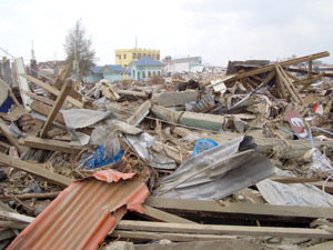 As photographed by Elder Daryl H. Garn, debris is strewn where thousands of homes once stood in Indonesia; thousands of lives were lost here in disaster.