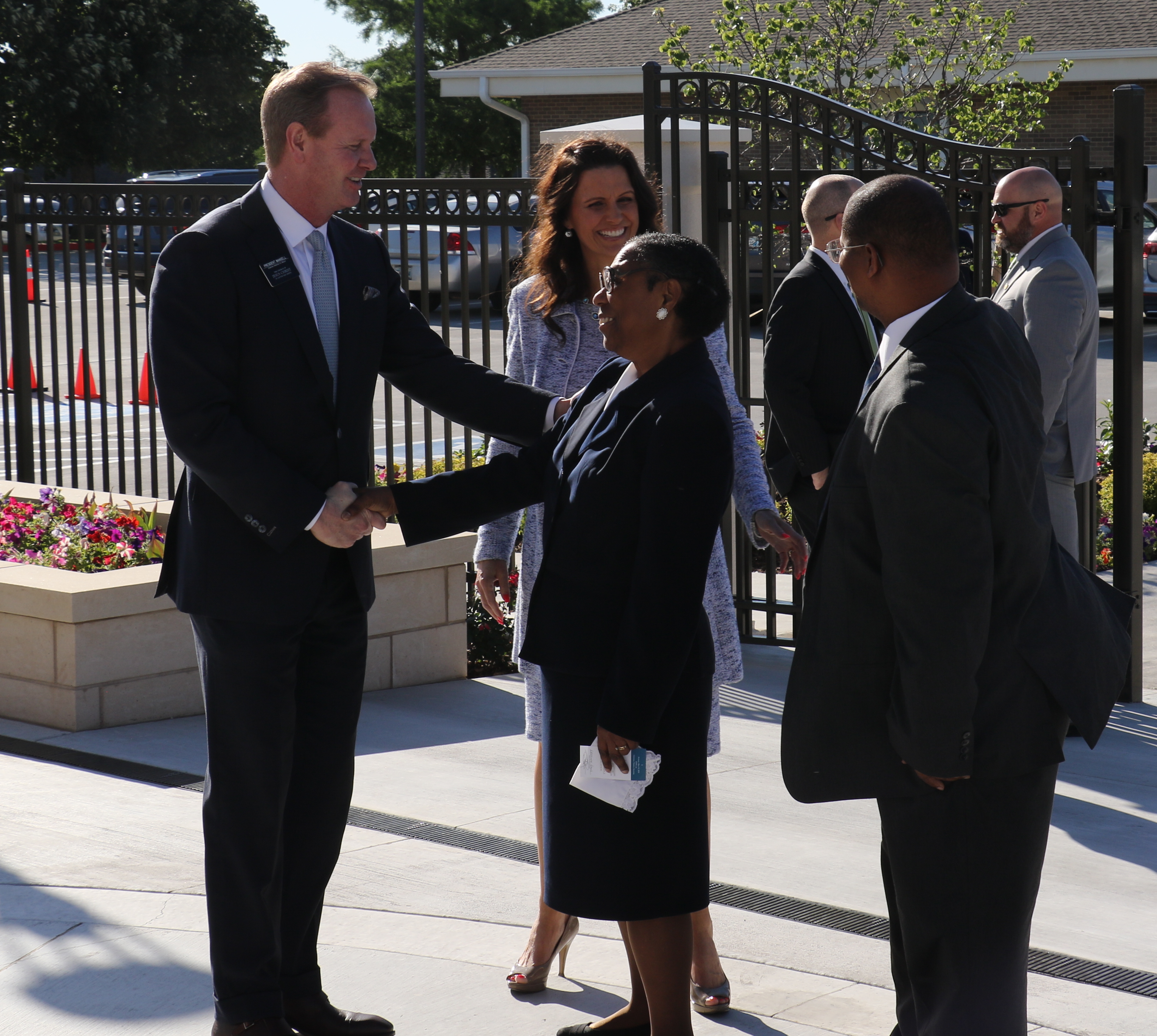 Oklahoma Oklahoma City Mission President Darren Mansell, at left, and Sister Shilane Mansell, greet friends gathering for the May 19, 2019, rededication of the Oklahoma City Oklahoma Temple.