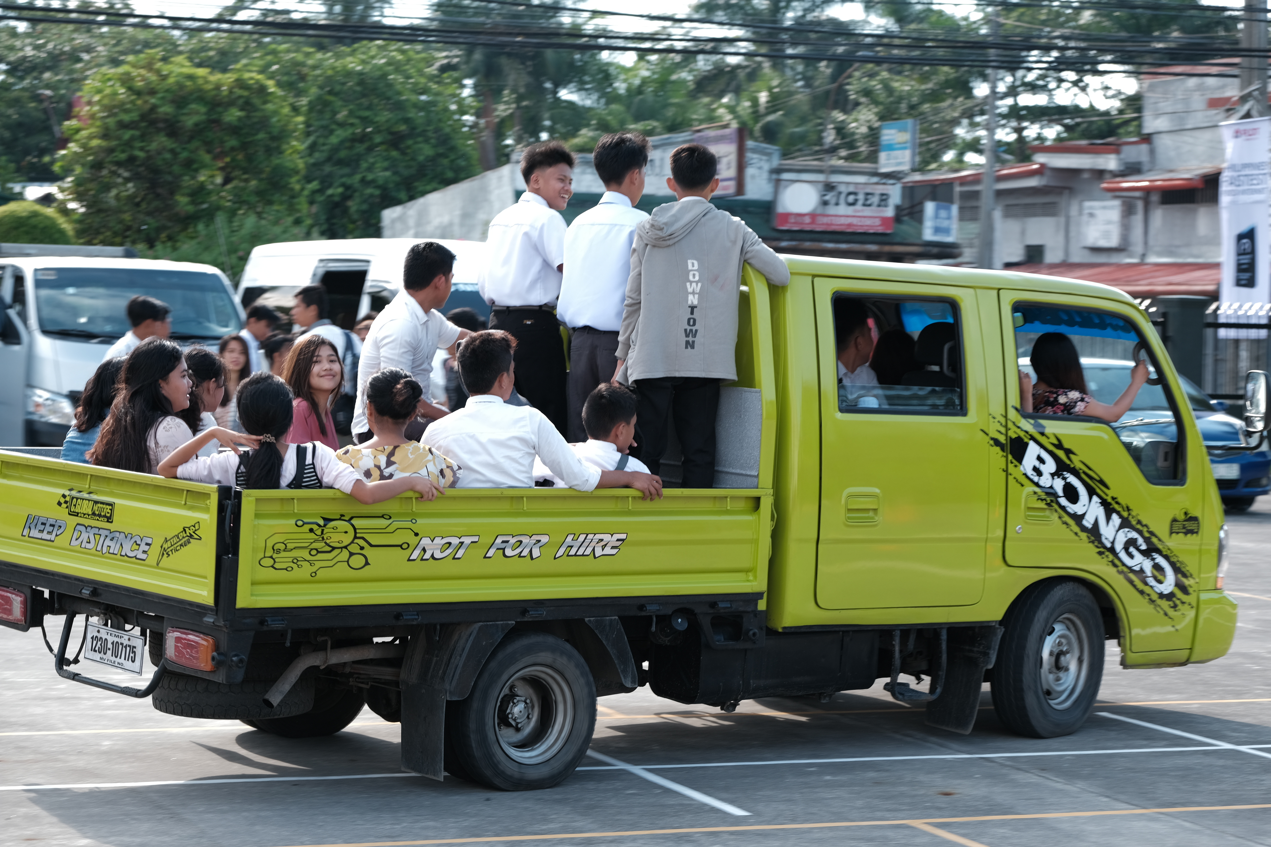 Members of the Church in Bacolod pile into a truck to attend a devotional with Elder Dale G. Renlund during his recent visit to the island nation.