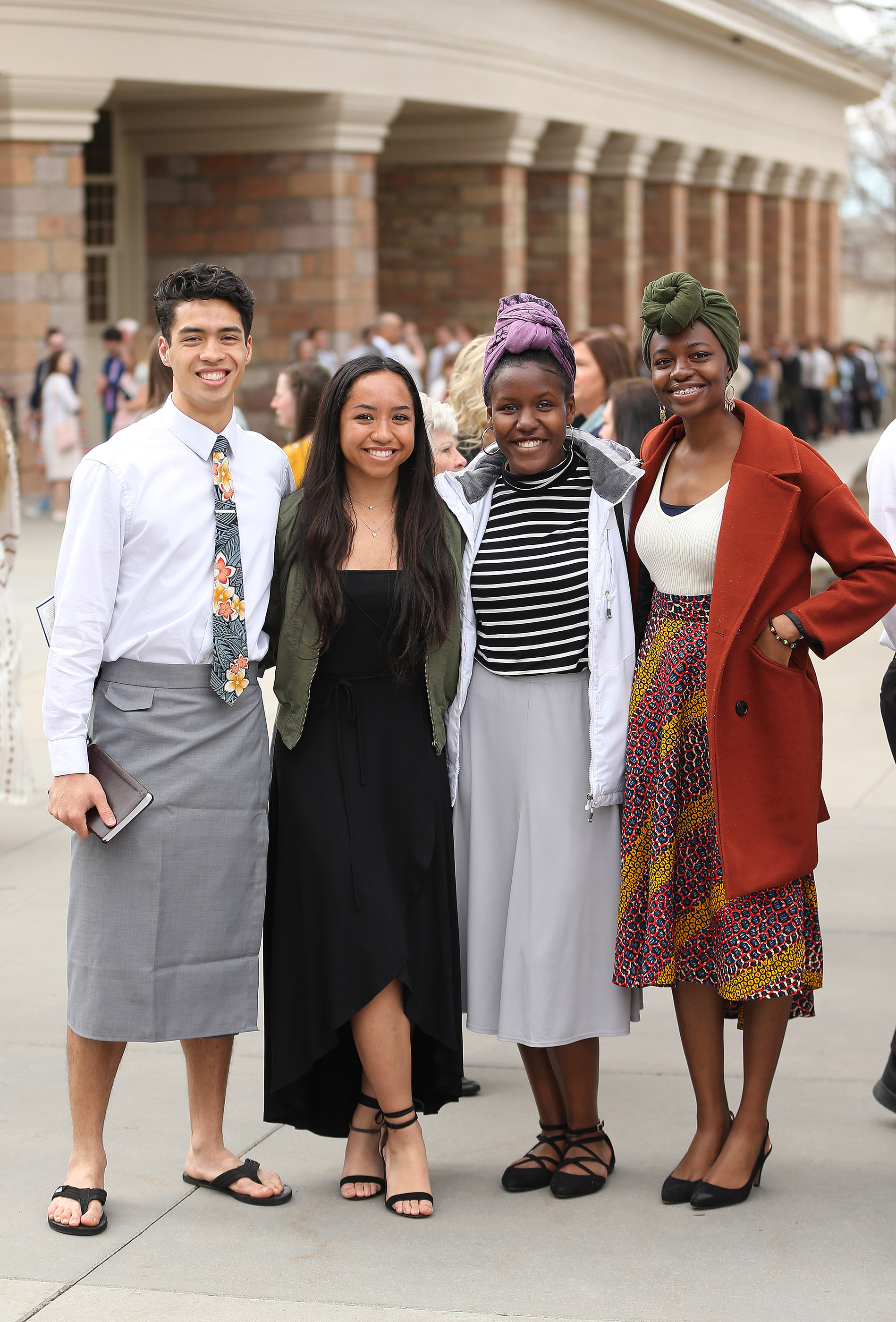 Kalawai'a Fano, Taliloa Fano, Kennethia Dorsey and Desiree Addo pause during the 189th Annual General Conference of The Church of Jesus Christ of Latter-day Saints in Salt Lake City on Sunday, April 7, 2019.