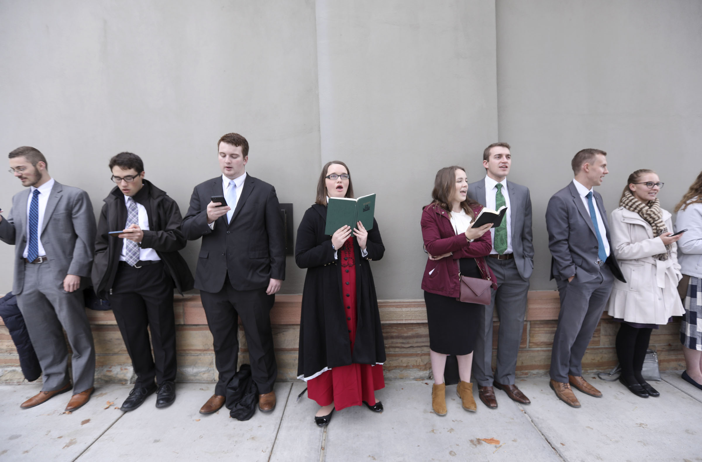 Members of the Logan Young Single Adults First Stake sing hymns between sessions of the 188th Semiannual General Conference of The Church of Jesus Christ of Latter-day Saints outside of Temple Square in downtown Salt Lake City on Sunday, Oct. 7, 2018.