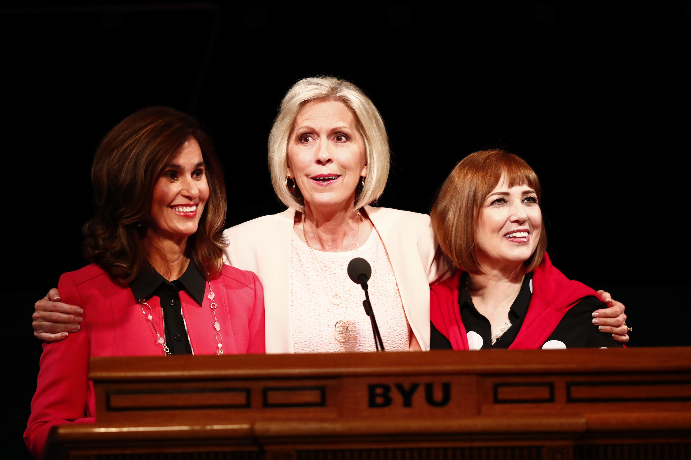 From left, Sister Lisa L. Harkness, Sister Joy D. Jones, and Sister Cristina B. Franco of the Primary general presidency speak in the Marriott Center at BYU during Women's Conference on May 4.