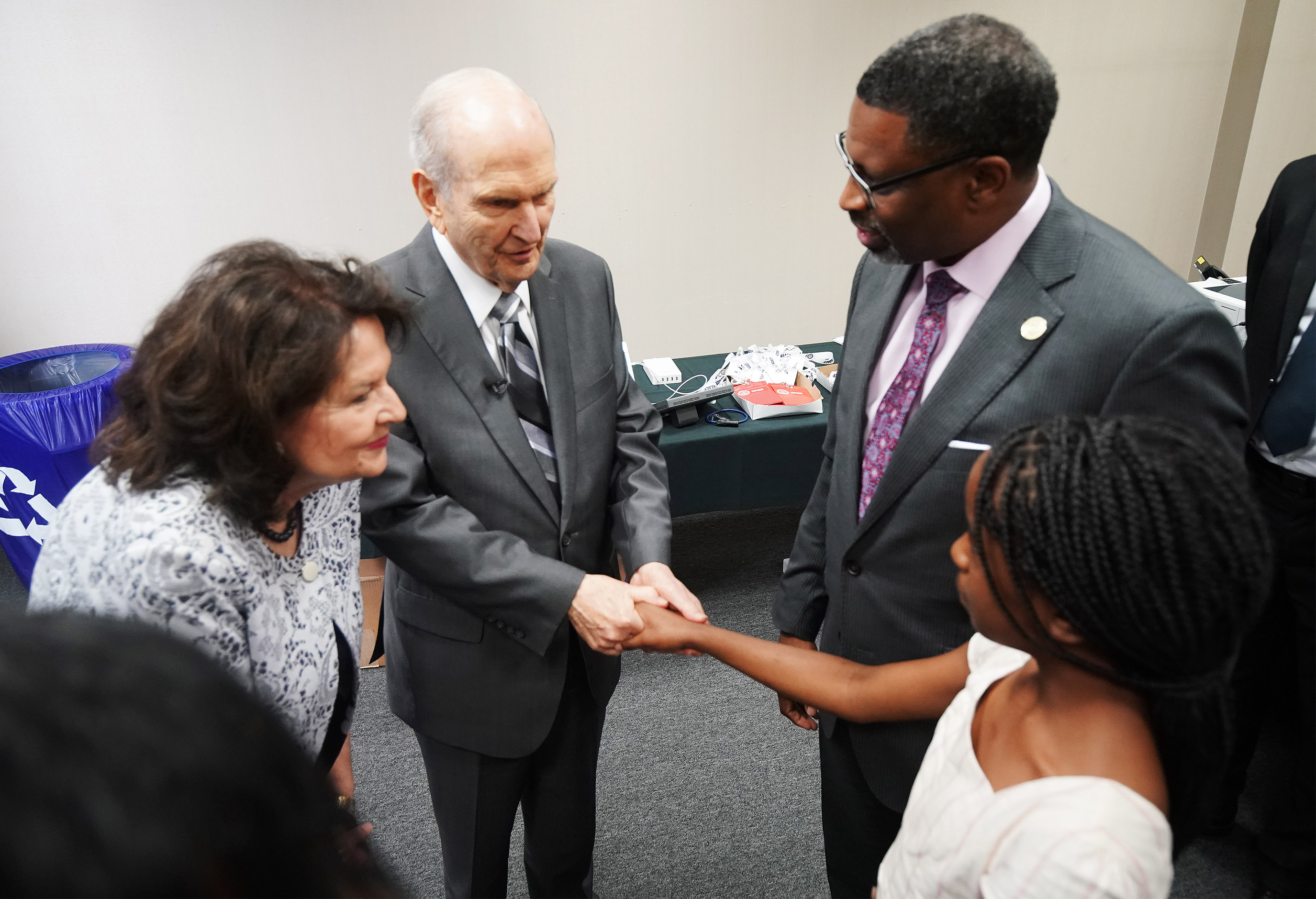 President Russell M. Nelson of The Church of Jesus Christ of Latter-day Saints and his wife Sister Wendy Nelson meet with Derrick Johnson and his daughter Safiya at the 110th annual national convention for the National Association for the Advancement of Colored People in Detroit on Sunday, July 21, 2019.