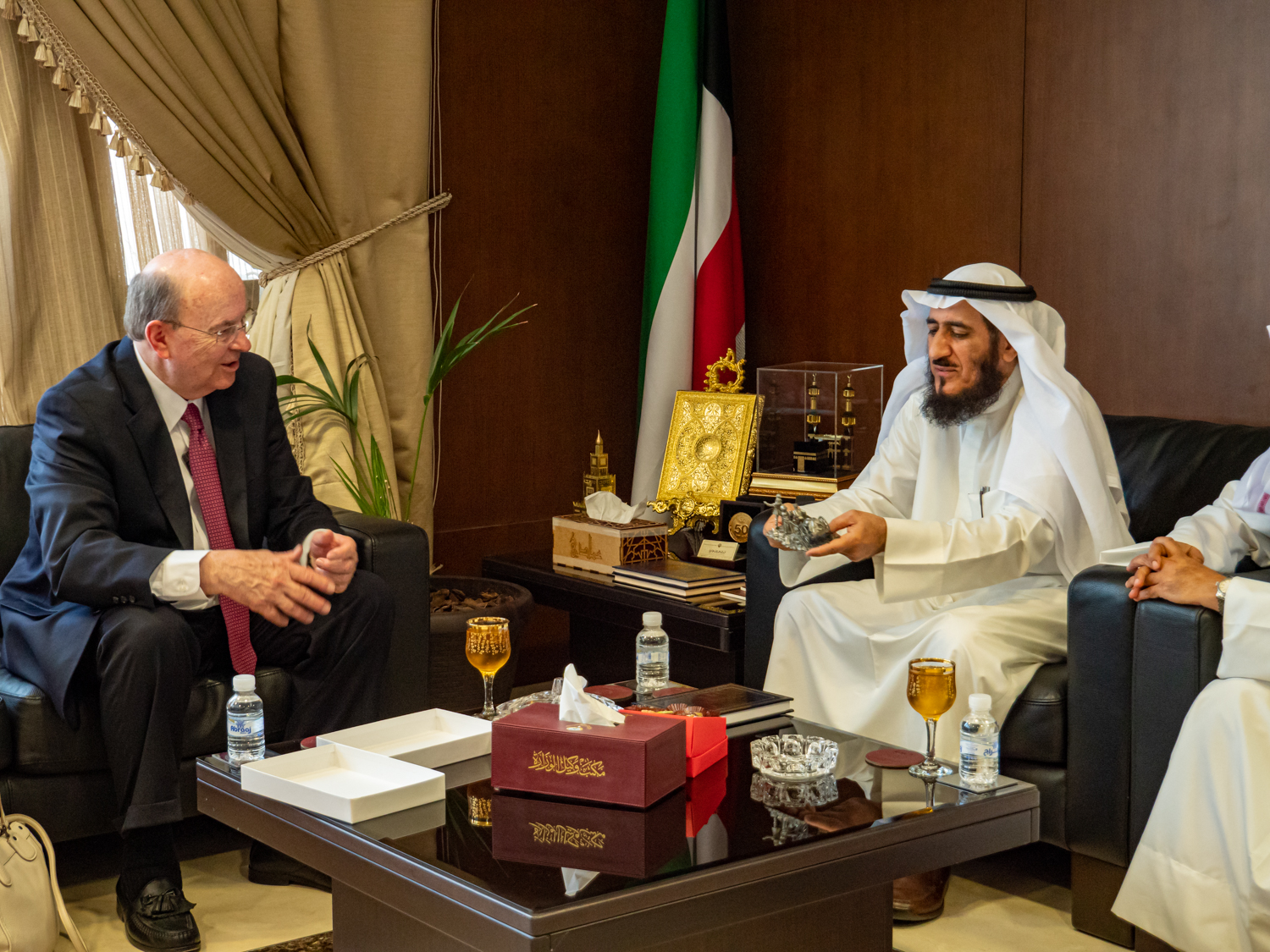 Elder Quentin L. Cook speaks to Mr. Fareed Emadi, secretary general of the Supreme Commission for the Promotion of Moderation in the Ministry of Awqaf, and others in Kuwait City on June 10, 2019.