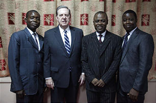 Upon creation of the Church's 3,000th stake and the first stake in Sierra Leone, Elder Jeffrey R. Holland poses with the presidency of the Freetown Sierra Leone Stake — President Patrick Swarray Jr., second from right, and his counselors Abibu S. Charles, left, and Theophilus Minnah.