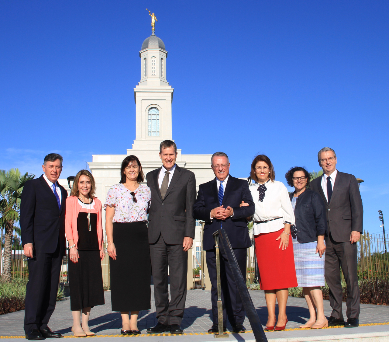 Church general authorities and their wives stand pause in front of the Fortaleza Brazil Temple on Saturday afternoon, June 1, 2019, a day before the temple's dedication. From left, Elder Adilson de Paula Parrella, a General Authority Seventy and counselor in Brazil Area; Sister Elaine Parrella; Sister Luisa Aidukaitis; Elder Marcos A. Aidukaitis, a General Authority Seventy and president of the Brazil Area; Elder Ulisses S. Soares of the Quorum of the Twelve Apostles; Sister Rosana Soares; Sister Mônica Godoy and Elder Carlos A. Godoy of the Presidency of the Seventy.