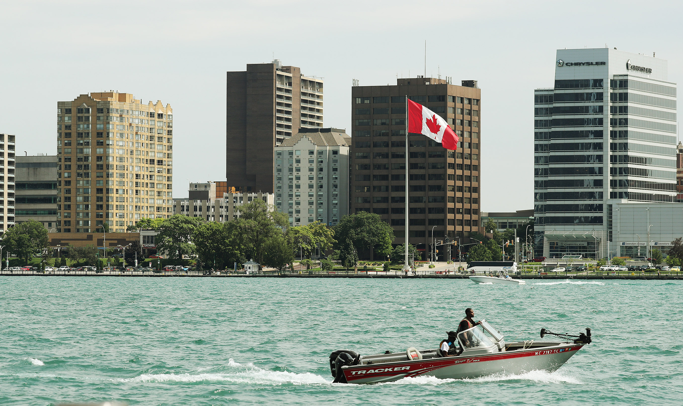 A boater has a view of Canada while on the Detroit River in Detroit, Michigan, on Sunday, July 21, 2019.