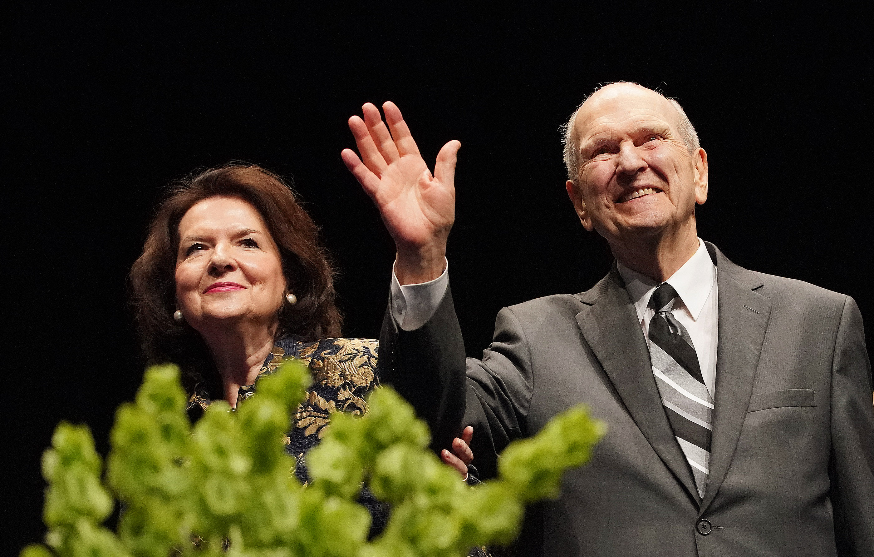 President Russell M. Nelson of The Church of Jesus Christ of Latter-day Saints and his wife, Sister Wendy Nelson, wave to devotional attendees on May 19, 2019, in Sydney, Australia.