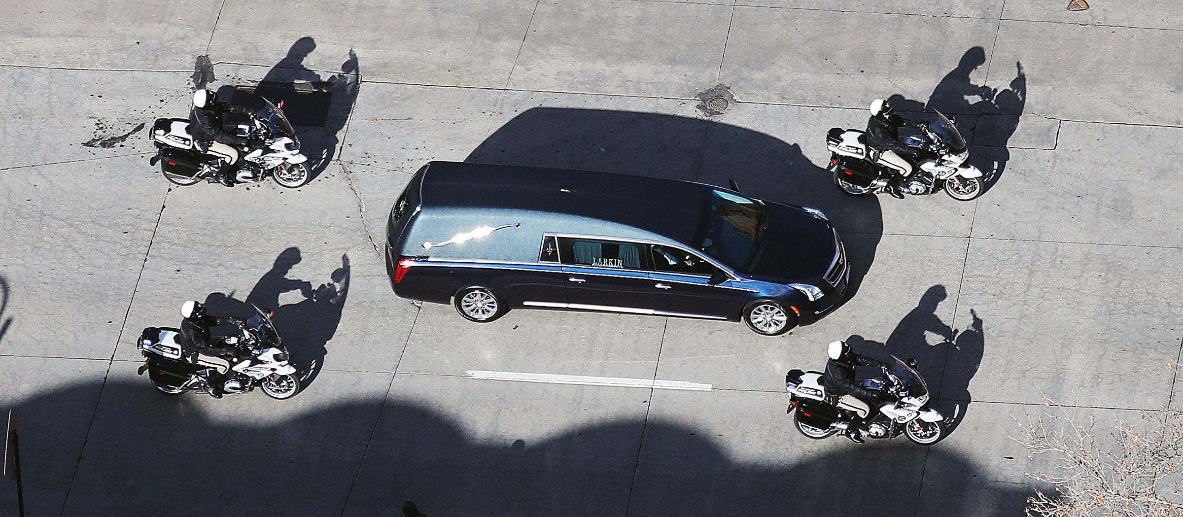 The funeral procession for Church President Thomas S. Monson makes its way to the Salt Lake City Cemetery on Friday, Jan. 12, 2018.