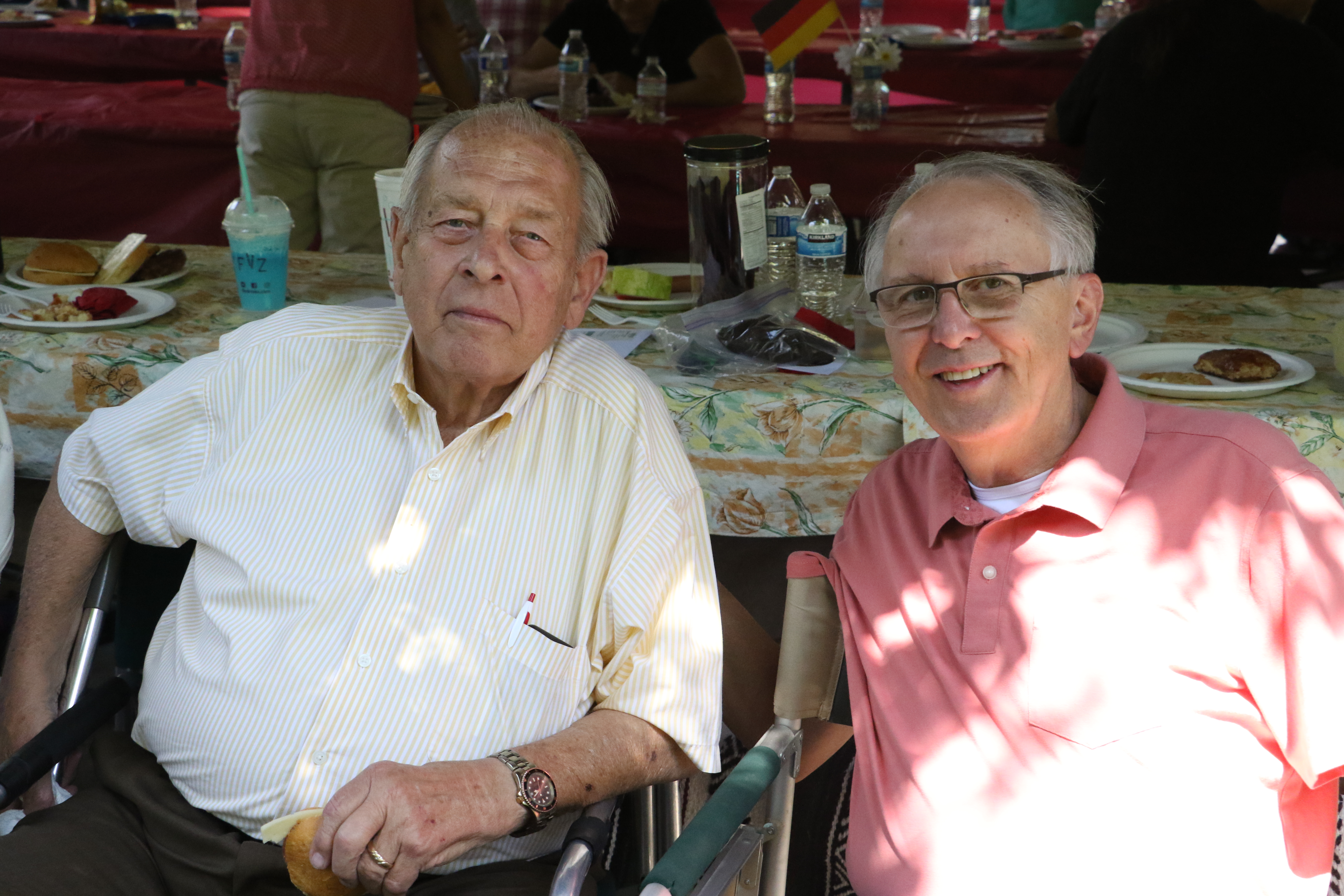Bishop Volker Diethelm Hagen of the German Speaking Ward and President Richard B. McKeown, the Salt Lake Central Stake president, pose for a photo together at the ward's picnic on July 13, 2019.