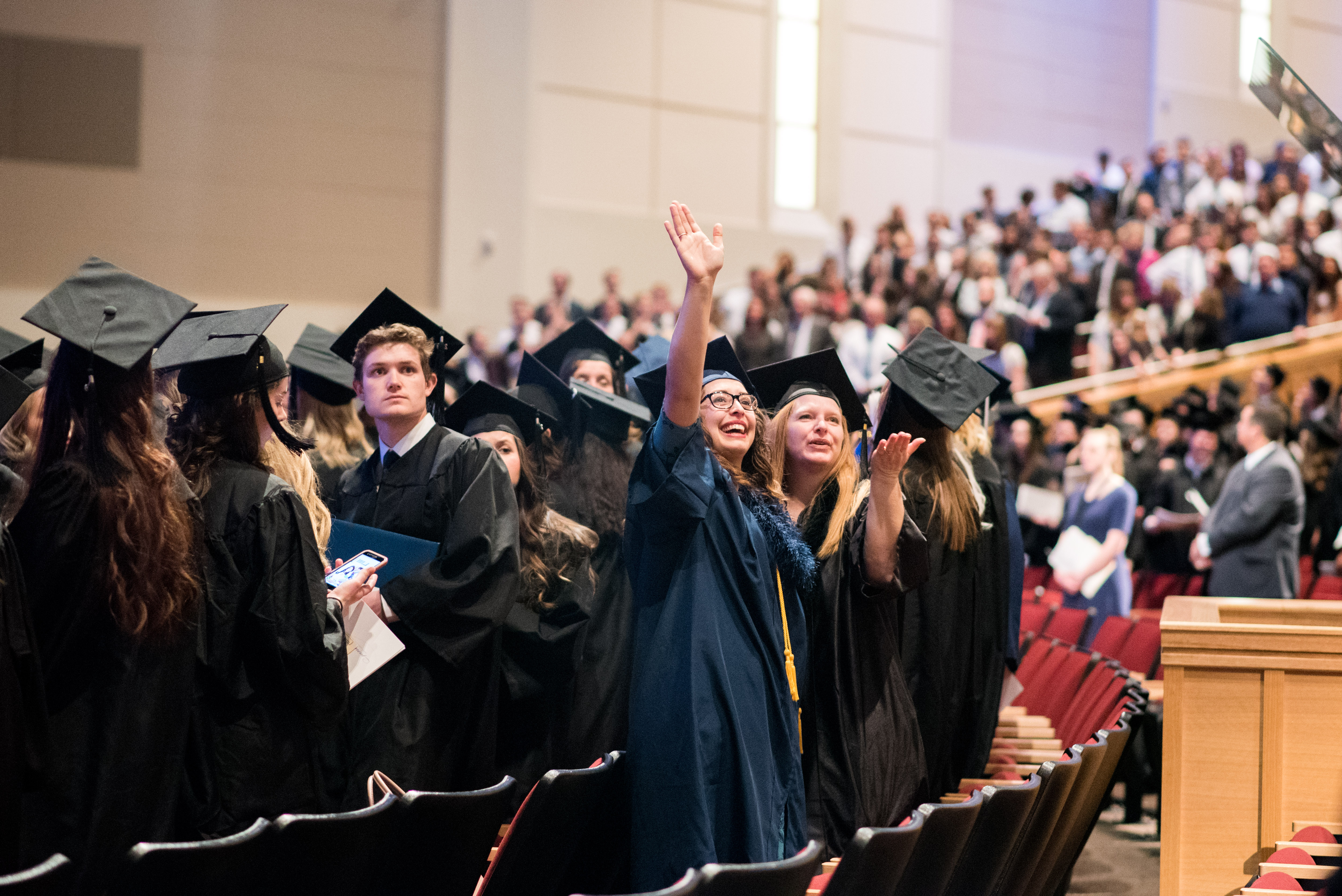 Graduates wave to friends and family at the April 12, 2019, Winter Semester Commencement at BYU-Idaho.