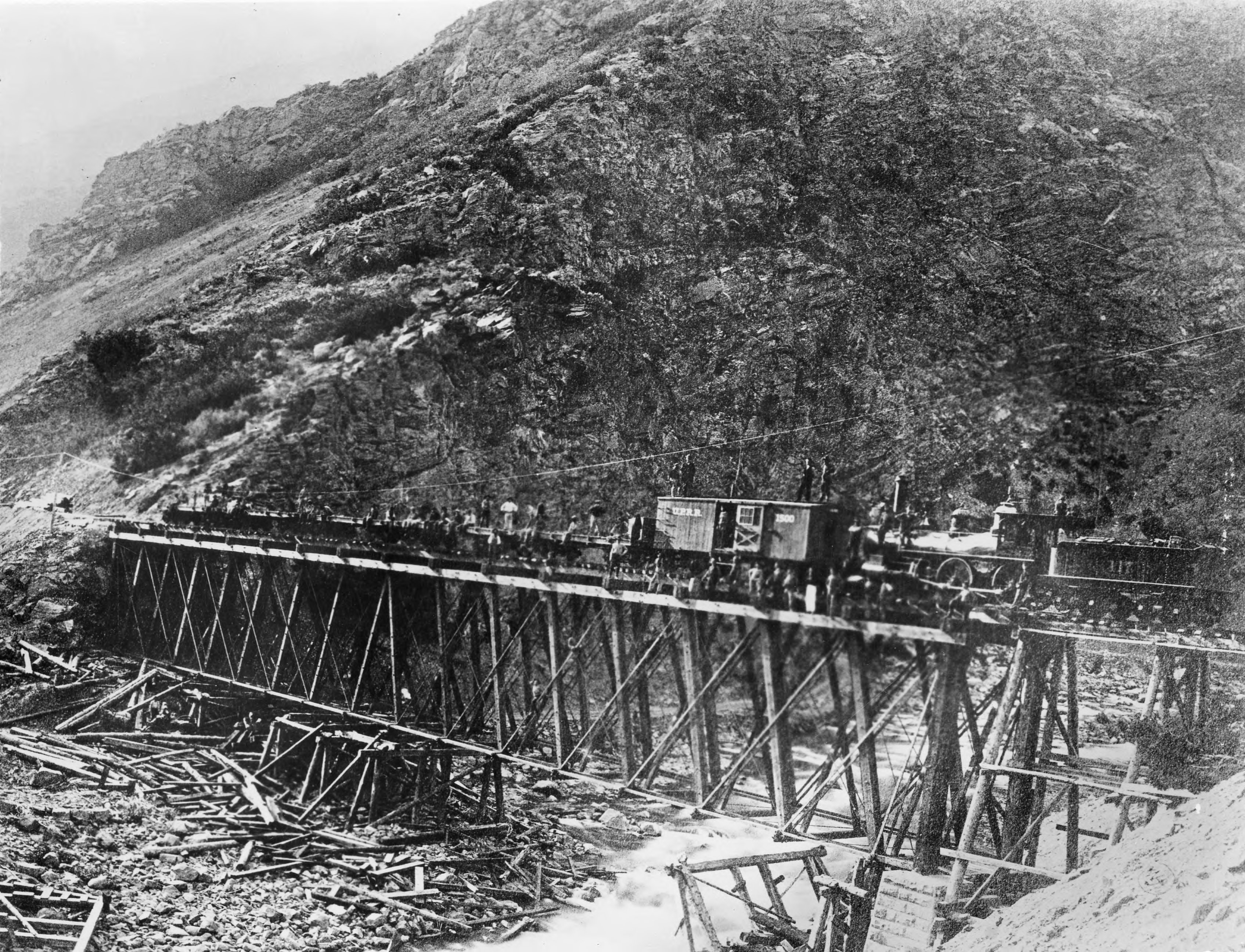 A construction train sits on Devil's Gate bridge in Utah during the building of the Union Pacific Railroad.