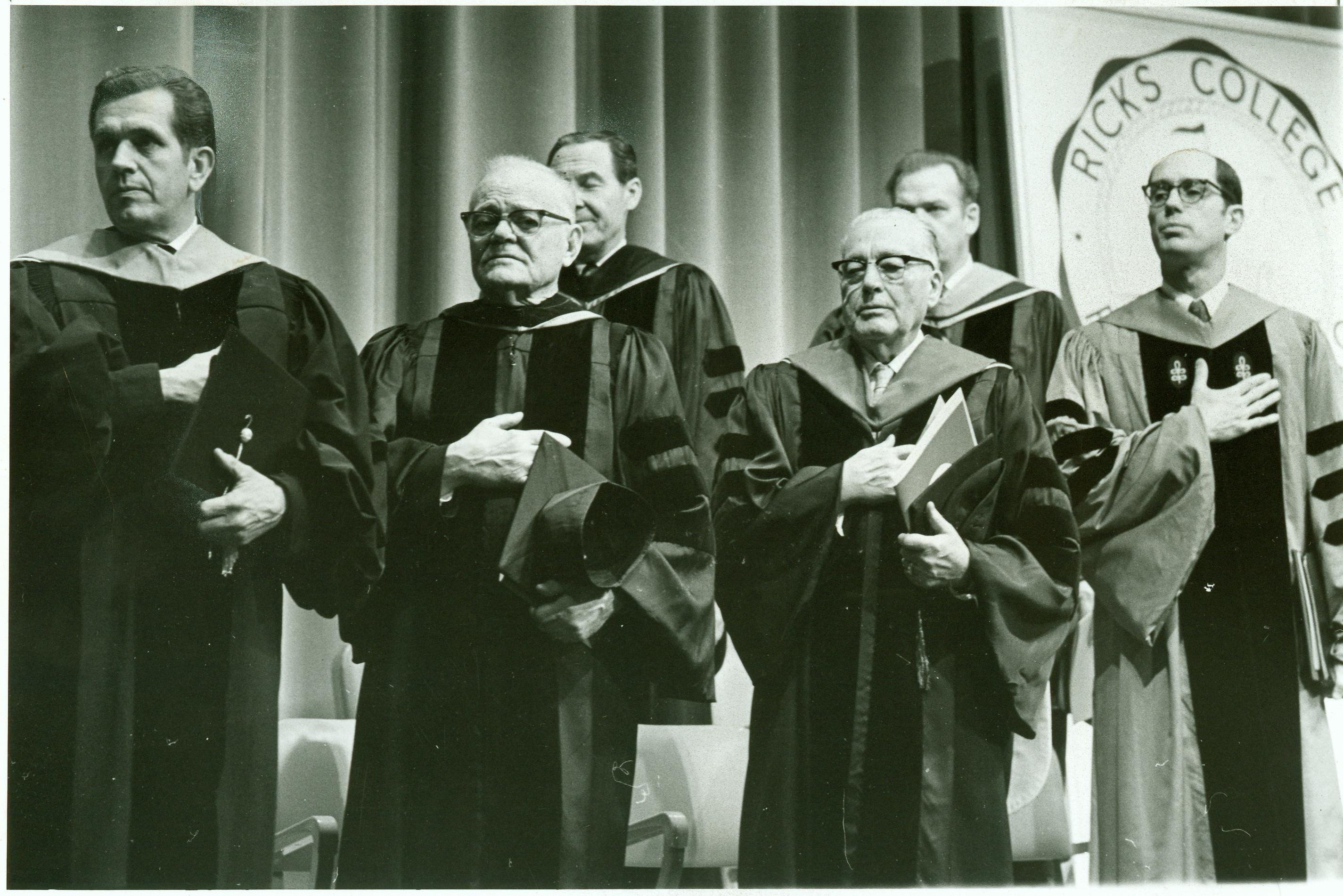 Elder Boyd K. Packer (from left), Elder Marion G. Romney, Bishop Robert L. Simpson, President Harold B. Lee, Elder Paul H. Dunn and Dr. Henry B. Eyring observe the flag ceremony at Dr. Eyring's inaugural at Ricks College.
