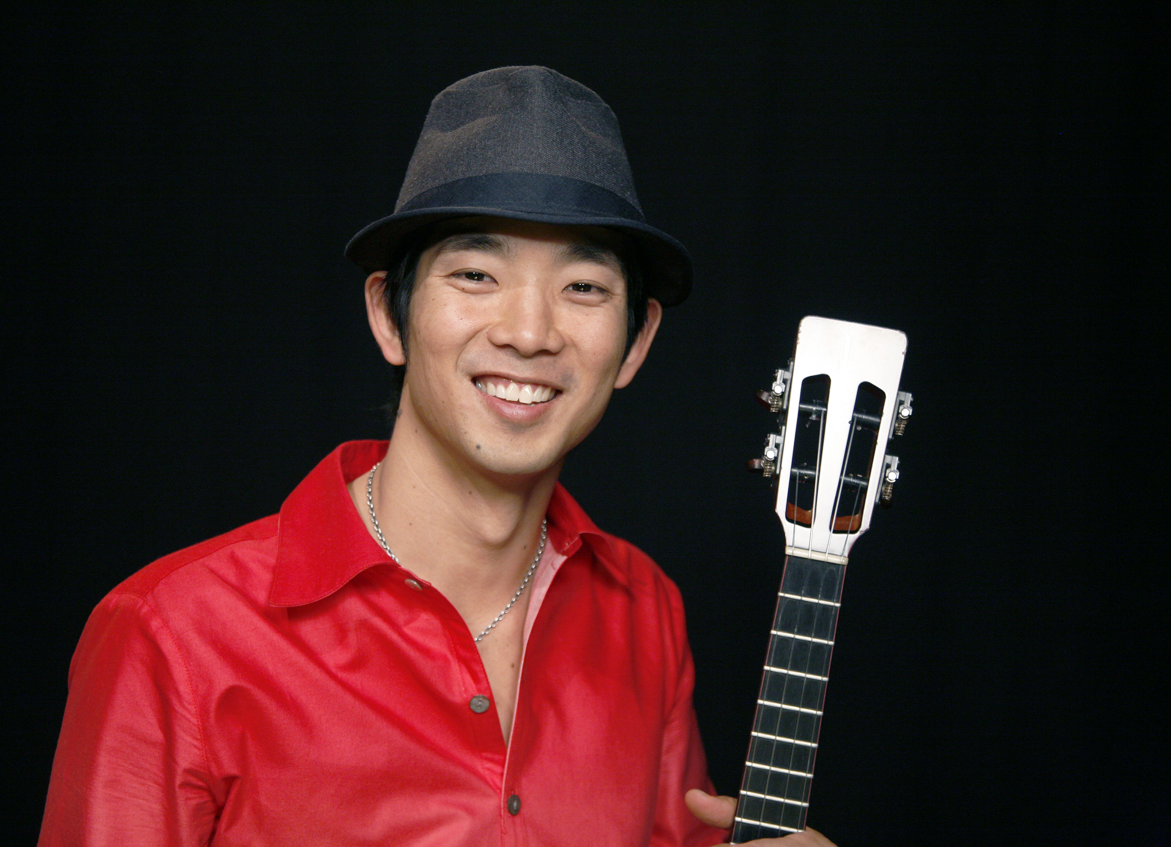 In this Jan. 24, 2011 photo, recording artist Jake Shimabukuro poses for a portrait in New York. Shimabukuro will appear at this year's RootsTech, scheduled for Feb. 27-March 2 at the Salt Palace Convention Center.