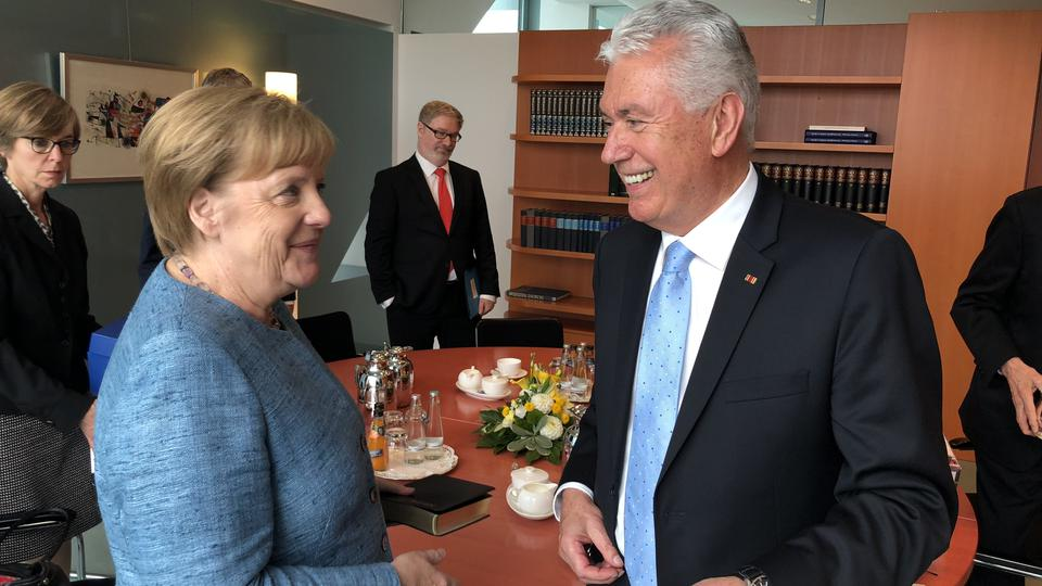Elder Dieter F. Uchtdorf of the Quorum of the Twelve Apostles meets with German Chancellor Angela Merkel in Germany, July 6, 2018.