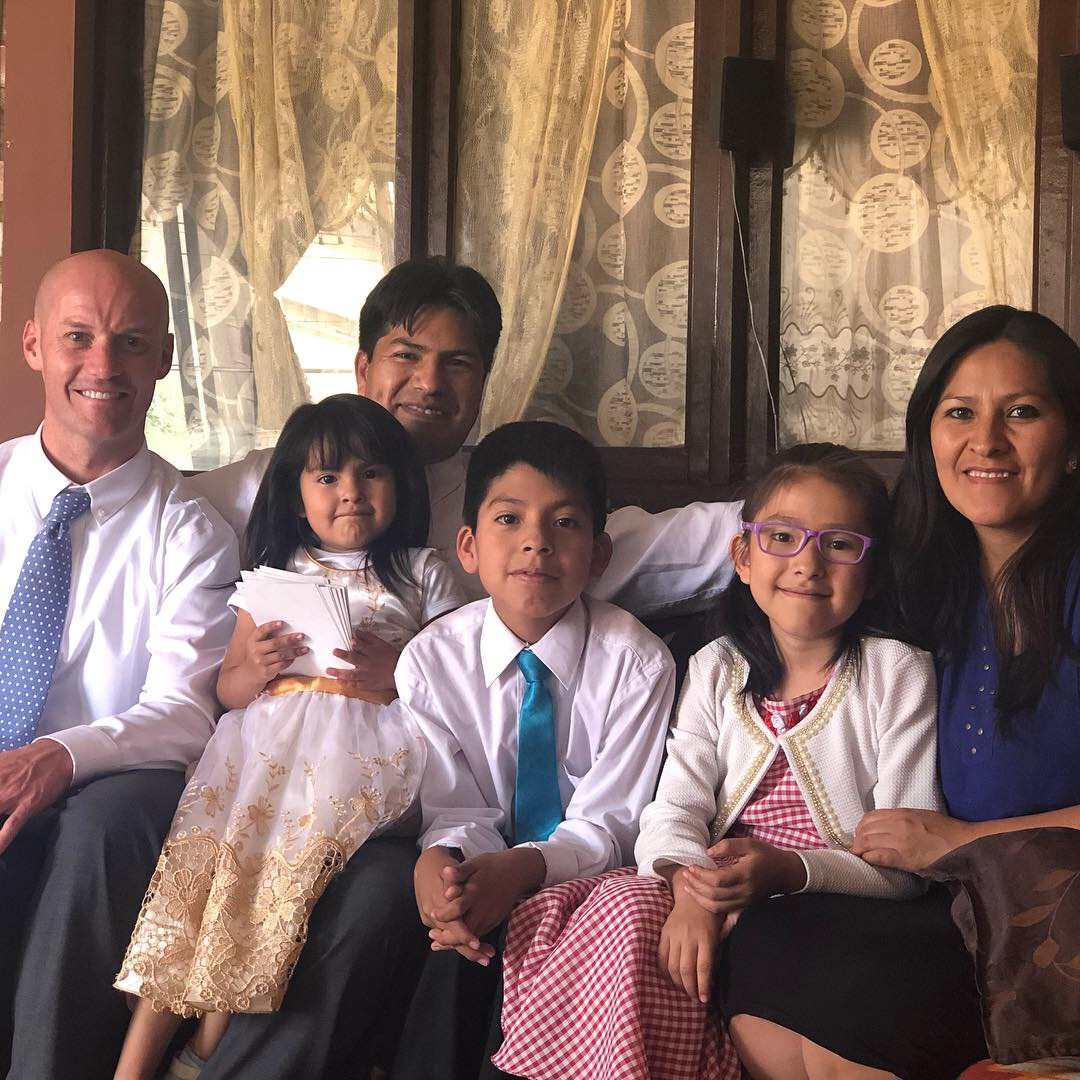 Scott Mortensen (left) with Gonzalo Cadiz and his family in October. Mortensen taught and baptized Cadiz as a youth some 20 years ago.