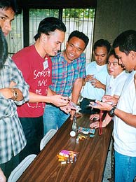 Trading exercises become games through which students learn business principles.