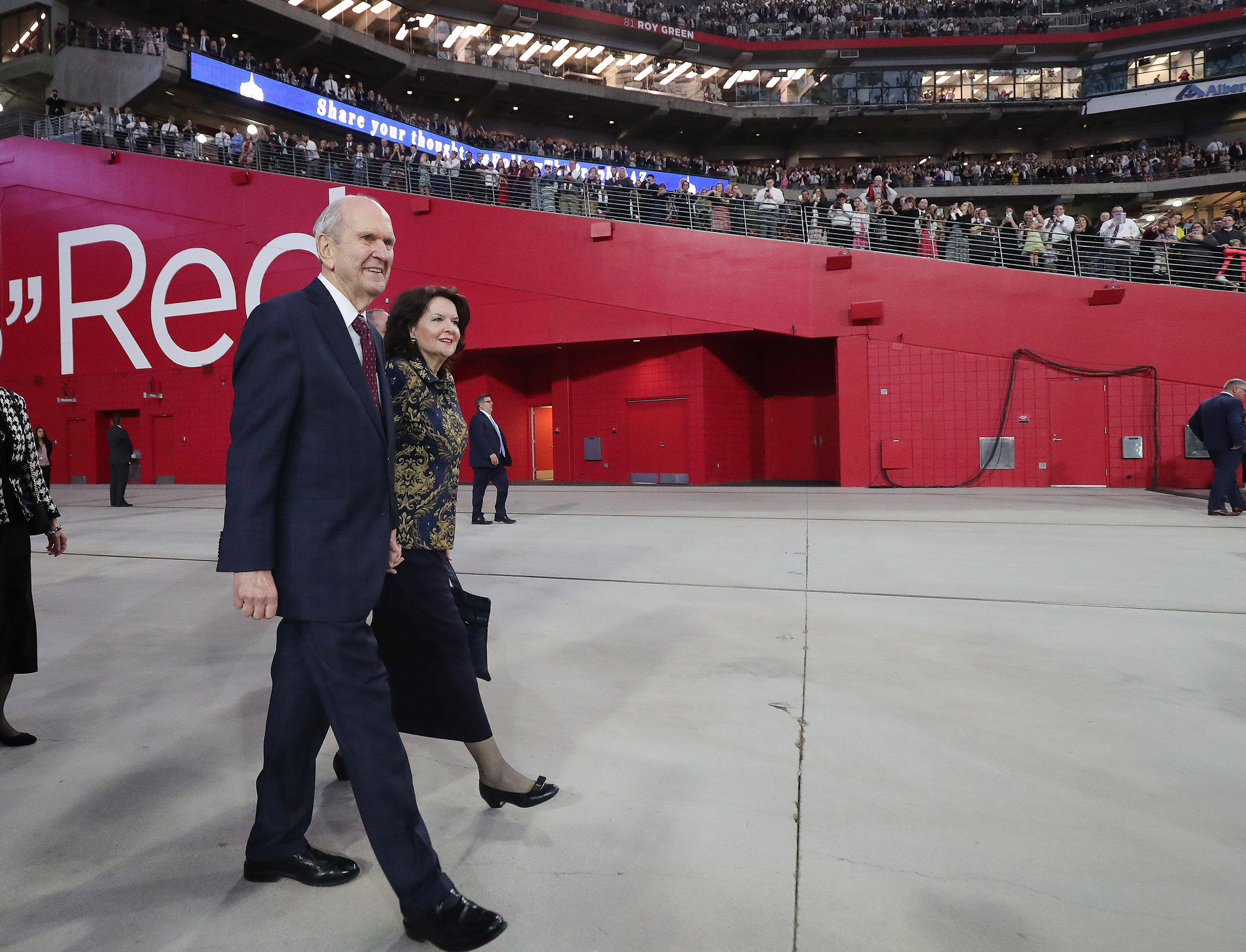 President Russell M. Nelson of The Church of Jesus Christ of Latter-day Saints and his wife, Sister Wendy Nelson, walk into the State Farm Stadium in Phoenix on Sunday, Feb. 10, 2019.