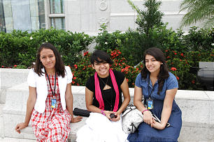 A trio of young women enjoy the gardens outside the El Salvador temple.