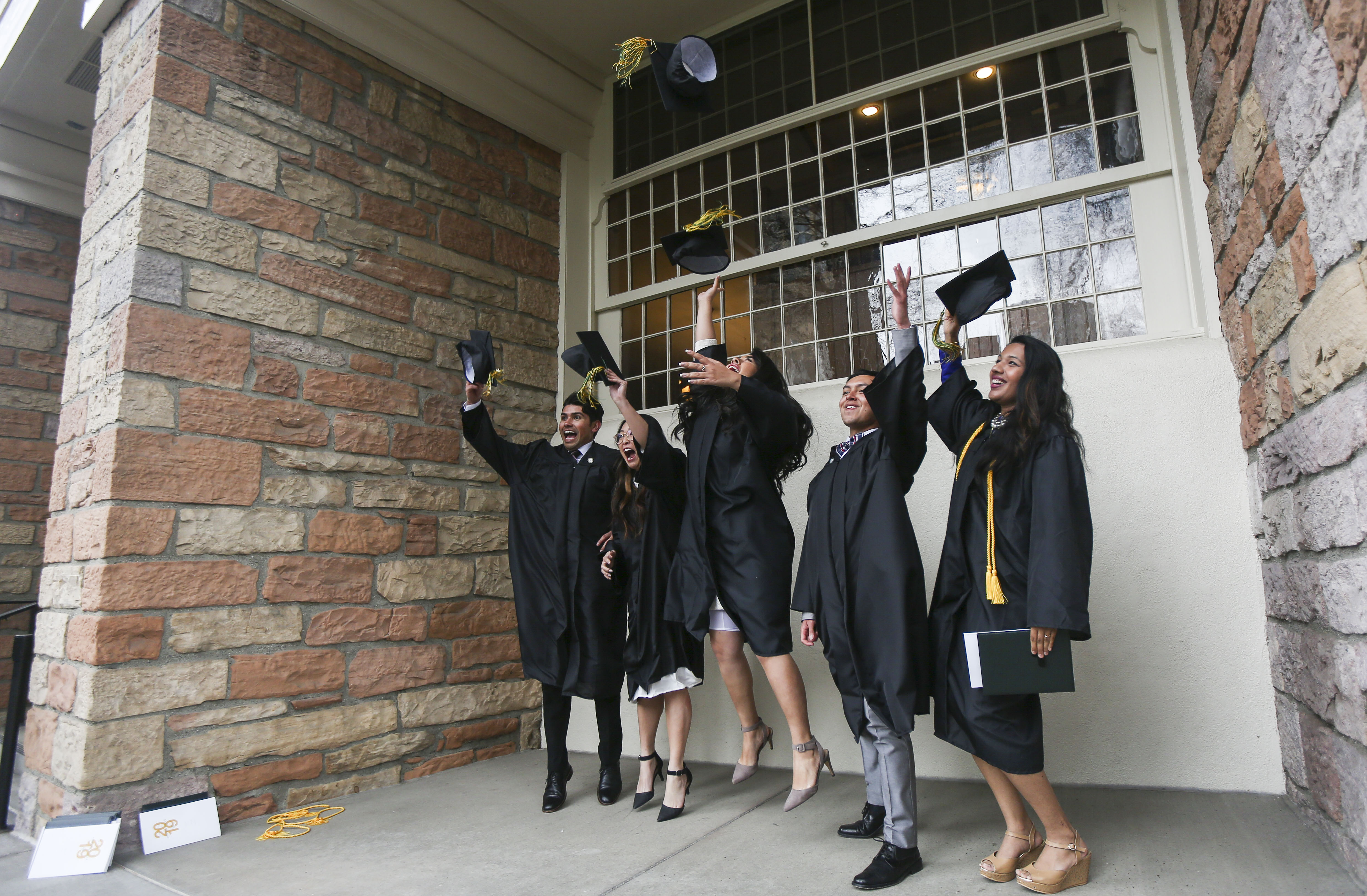 Students from the LDS business college celebrate their graduation at Tabernacle at Temple Square after their commencement ceremony in Salt Lake City on Friday, April 12, 2019.