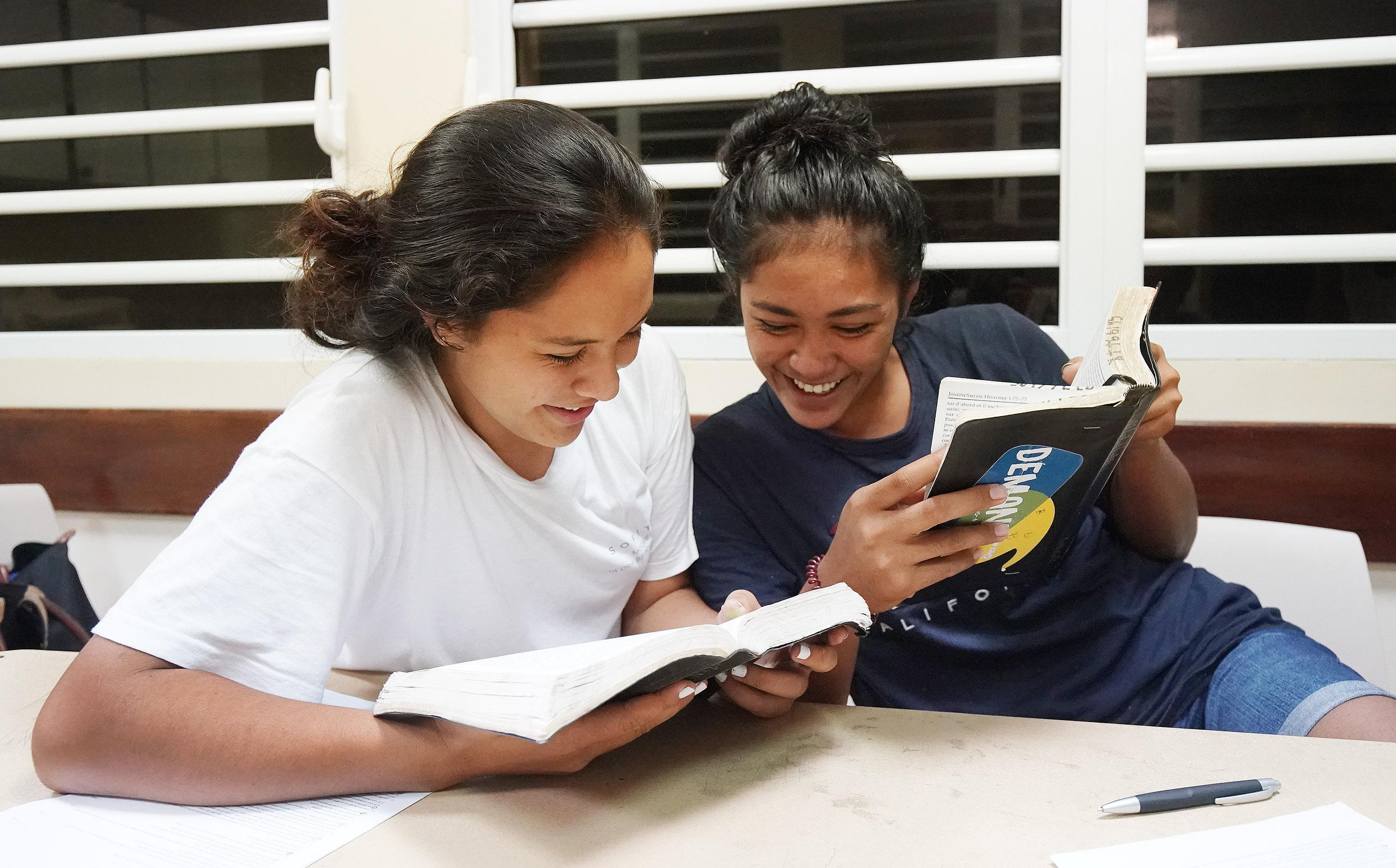 Desiree Tetuanui and Hauhere Nauta read scriptures during Latter-day Saint seminary in Bora Bora on May 28, 2019.