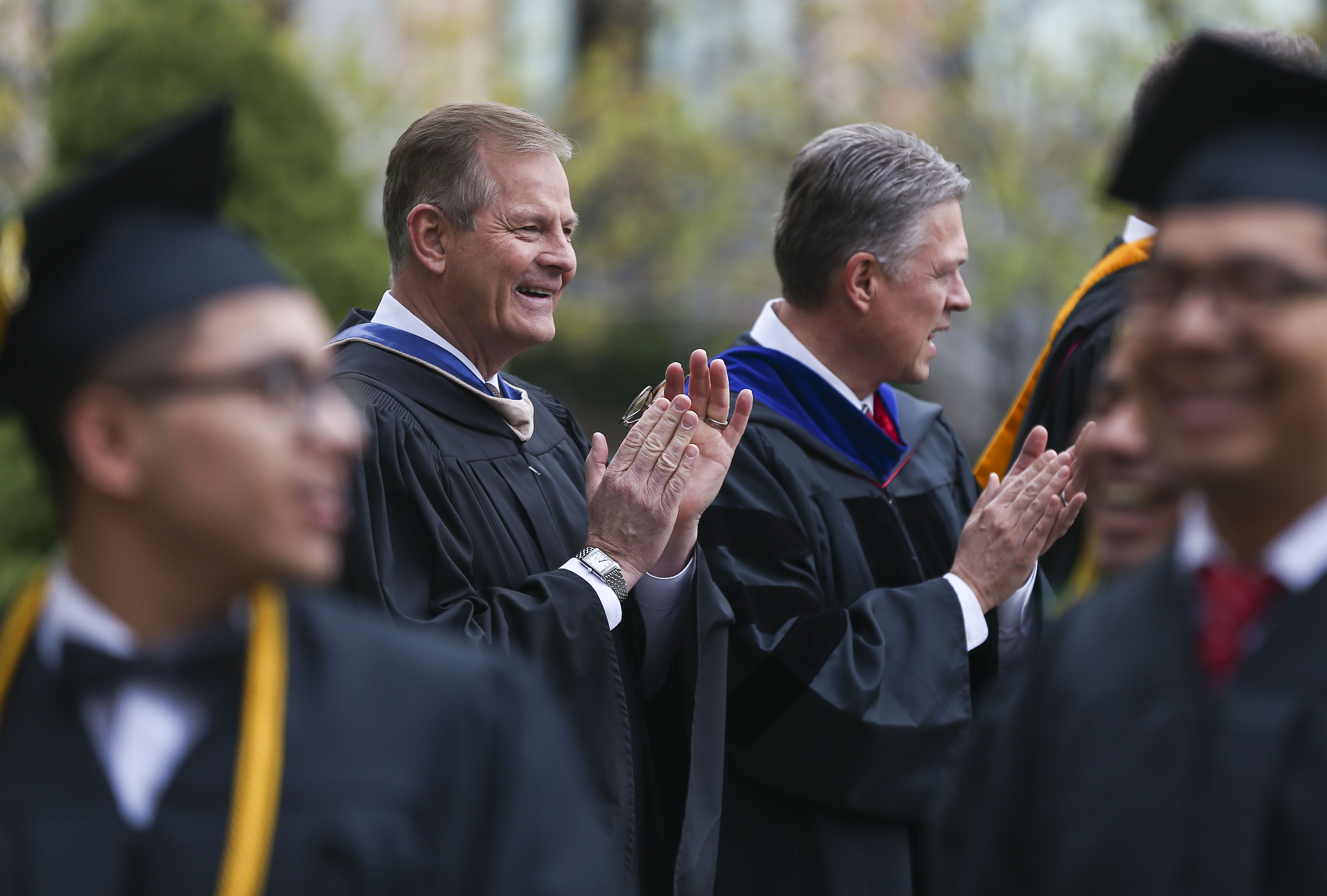 Elder Gary E. Stevenson of the Quorum of the Twelve Apostles greets students arriving for the commencement ceremony for the LDS Business College at the Tabernacle at Temple Square in Salt Lake City on Friday, April 12, 2019.