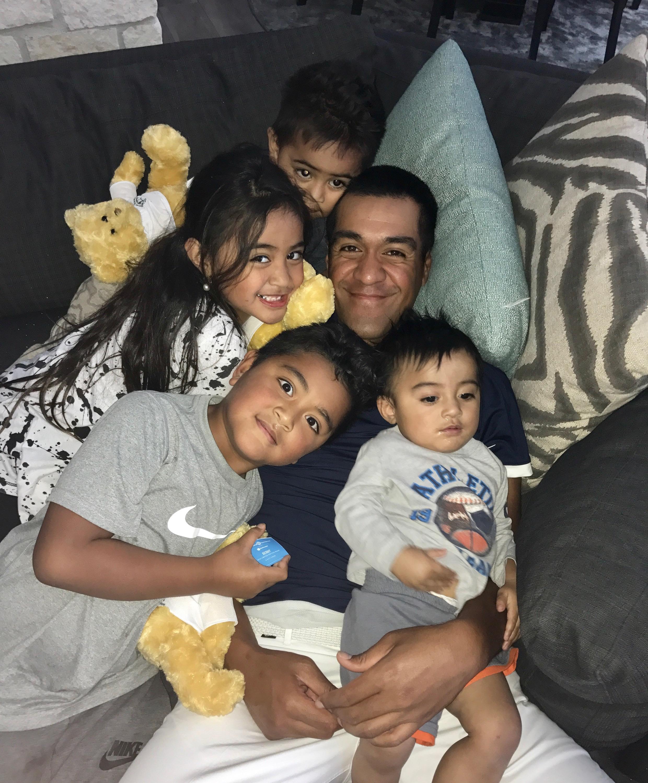 Tony Finau with his four children.