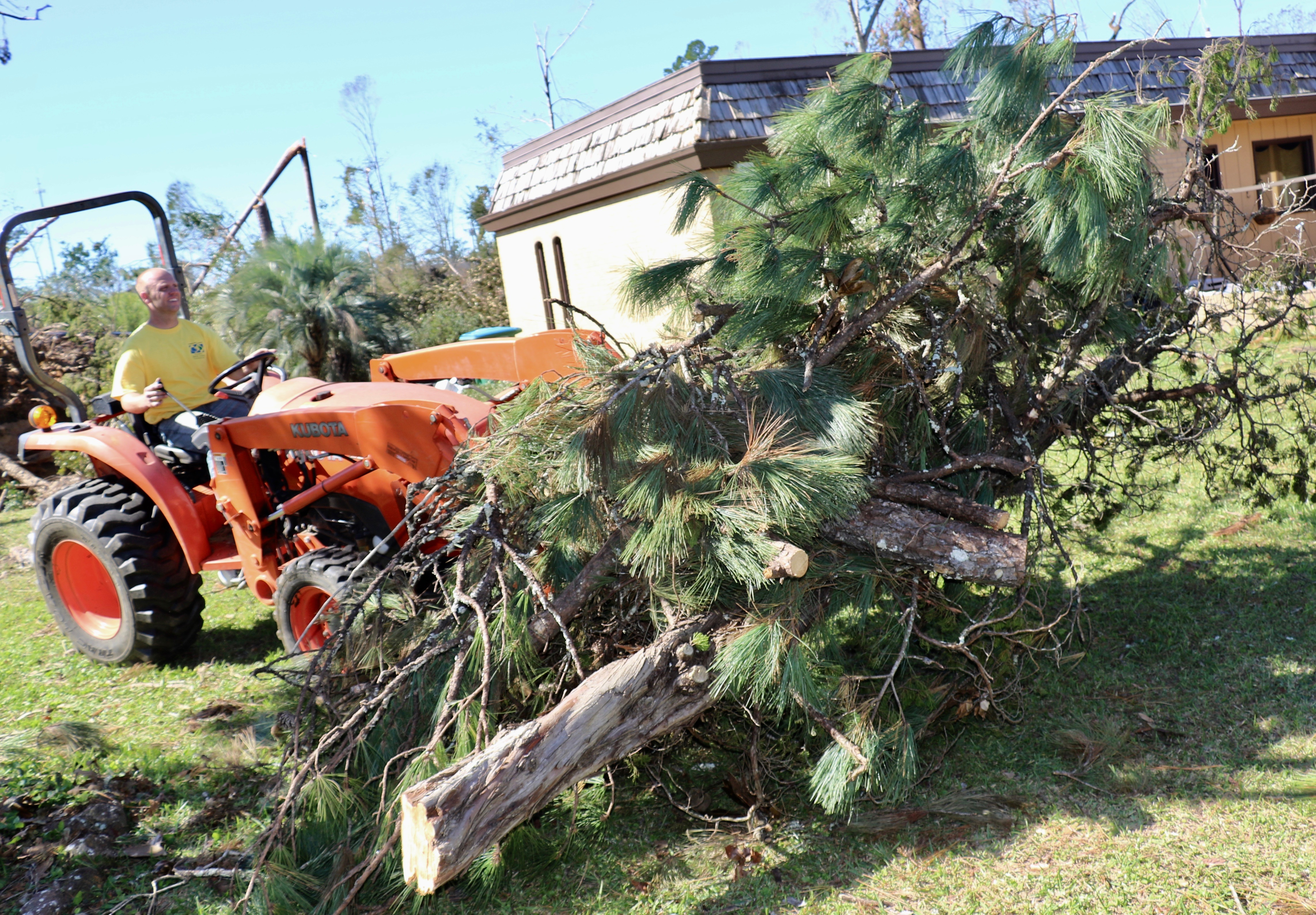 Daniel Wemberly commandeers tractor to clear out fallen trees in Marianna, Florida.