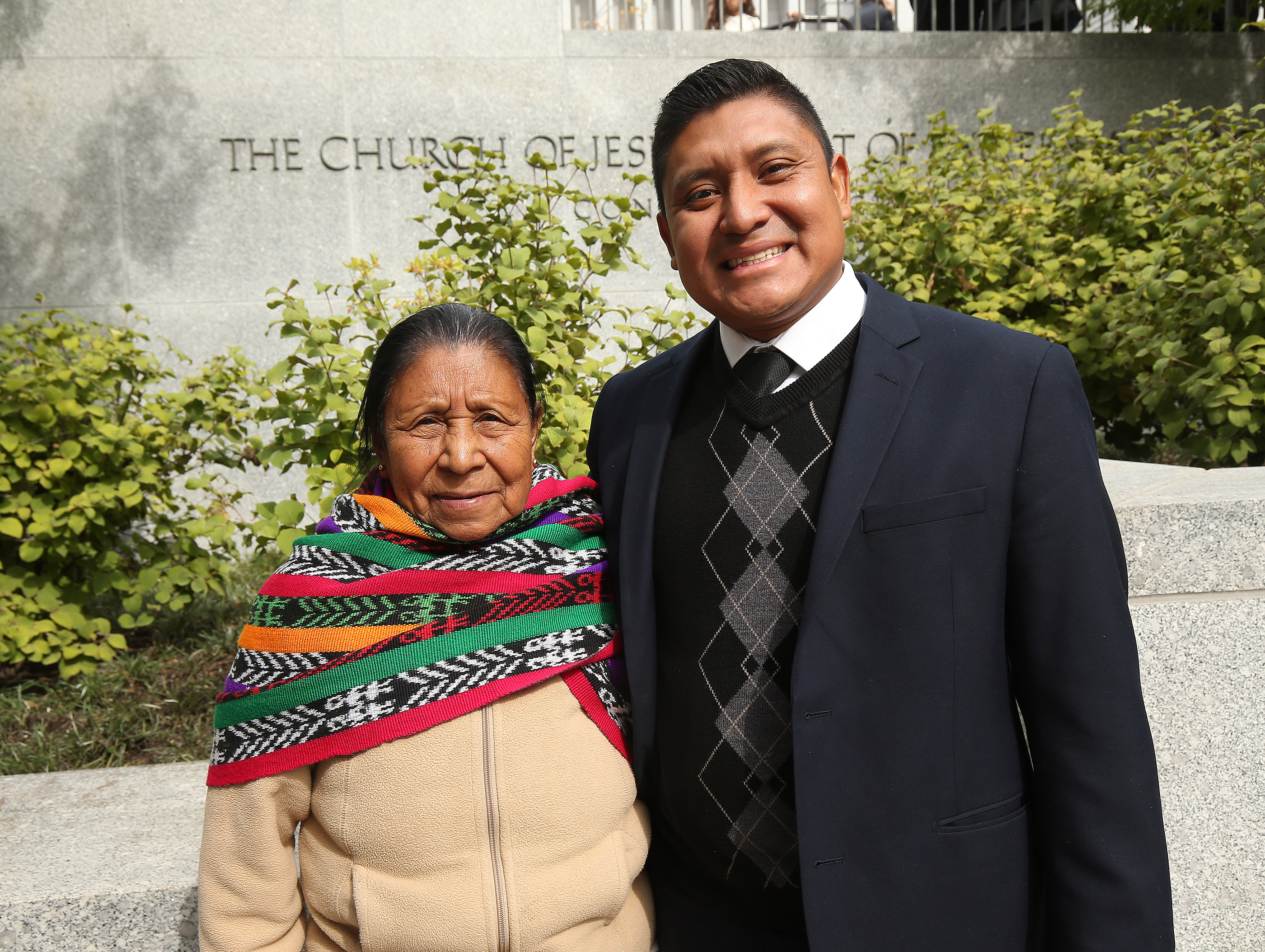 William Boror and his mother, Maria Valazquez, attend the 188th Semiannual General Conference of The Church of Jesus Christ of Latter-day Saints in Salt Lake City on Saturday, Oct. 6, 2018.