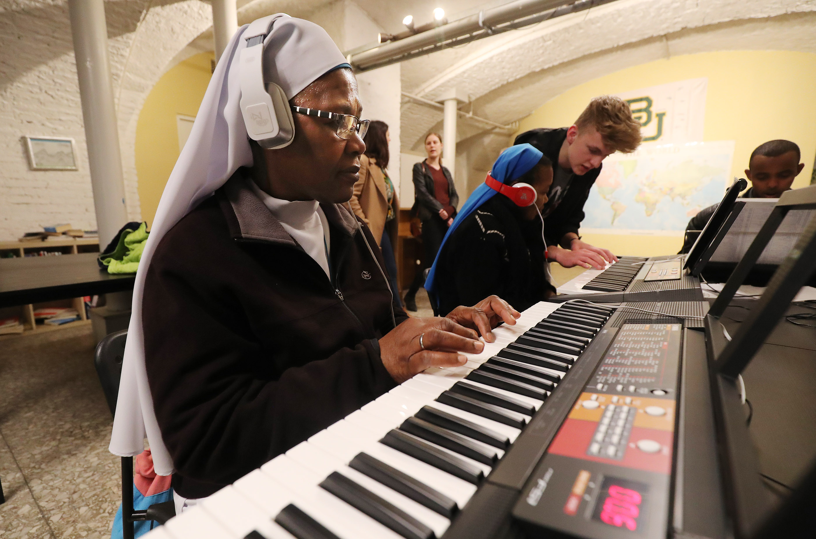 A Catholic Nun Sister Margaret practices piano during a class taught by Josh Perego, a local Latter-day Saint.