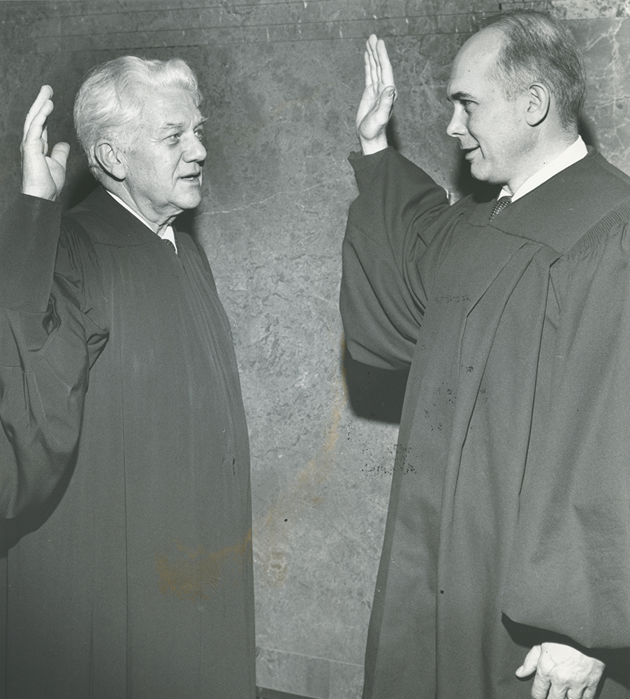 Newly sworn-in Chief Justice Richard J. Maughan administers oath to Dallin H. Oaks, former BYU president.