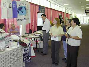 Conference-goers view hallway exhibits.