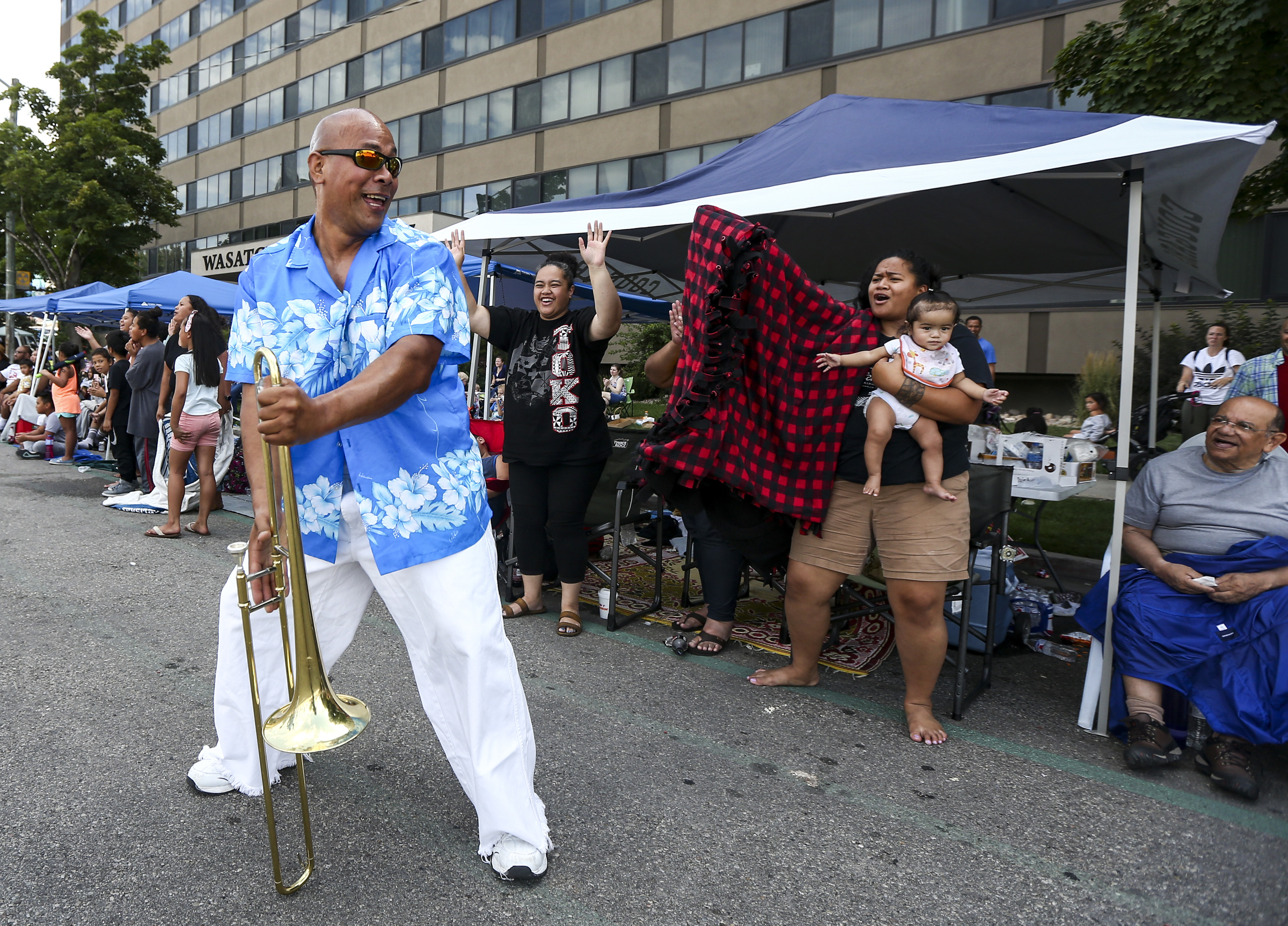 To a Naivalca with the Liahona Alumni Band shakes it for a few parade goers during the Days of 47 Parade in Downtown Salt Lake City on Wednesday, July 24, 2019.