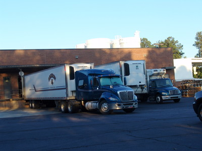 Trucks are loaded with supplies at the Tucker, Ga., Bishops' Storehouse for transport into areas affected by severe weather.