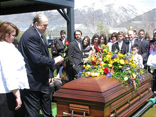 Funeral of Elder Jack H. Goaslind Jr. on May 2, 2011.Tuesday, May3, 2011. At gravesite, President Thomas S. Monson places a rose on the casket of Elder Goaslind.