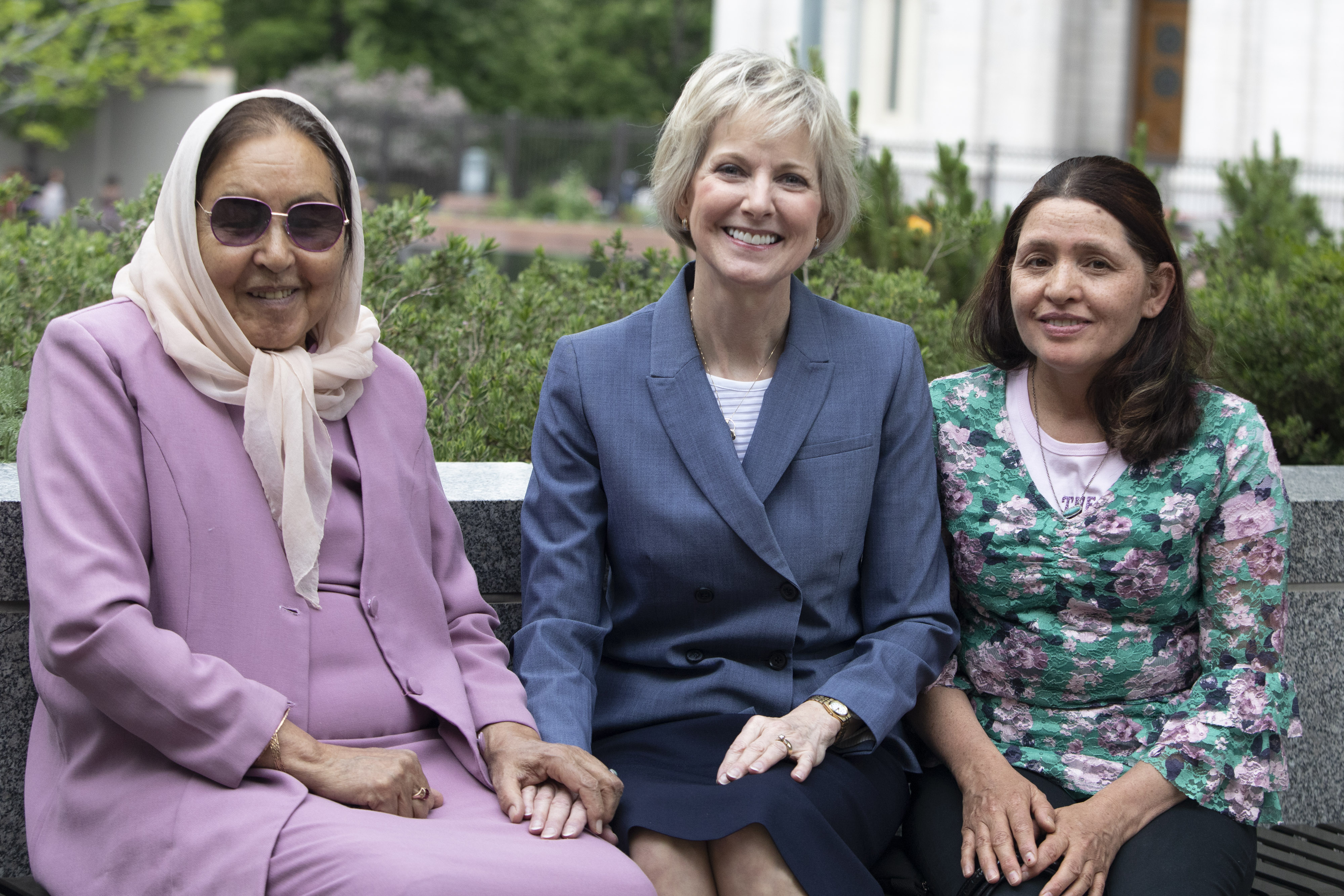 Sister Jean B. Bingham and her friends Asifa Nadir, left, and Nadira Nadir sit outside the Relief Society Building on Temple Square prior to an interview with representatives from USA for UNHCR on May 16, 2019. Sister Bingham has known the Nadir family, refugees from Afghanistan for nearly 15 years.