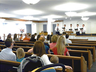 Young men from Colonial First and Colonial Second wards perform in chapel during open house.