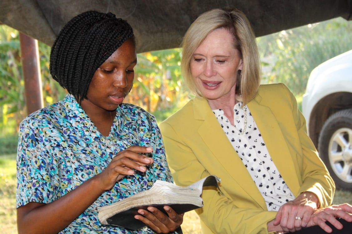 Sister Bonnie H. Cordon, Young Women general president, meets with a member in Maputo, Mozambique.