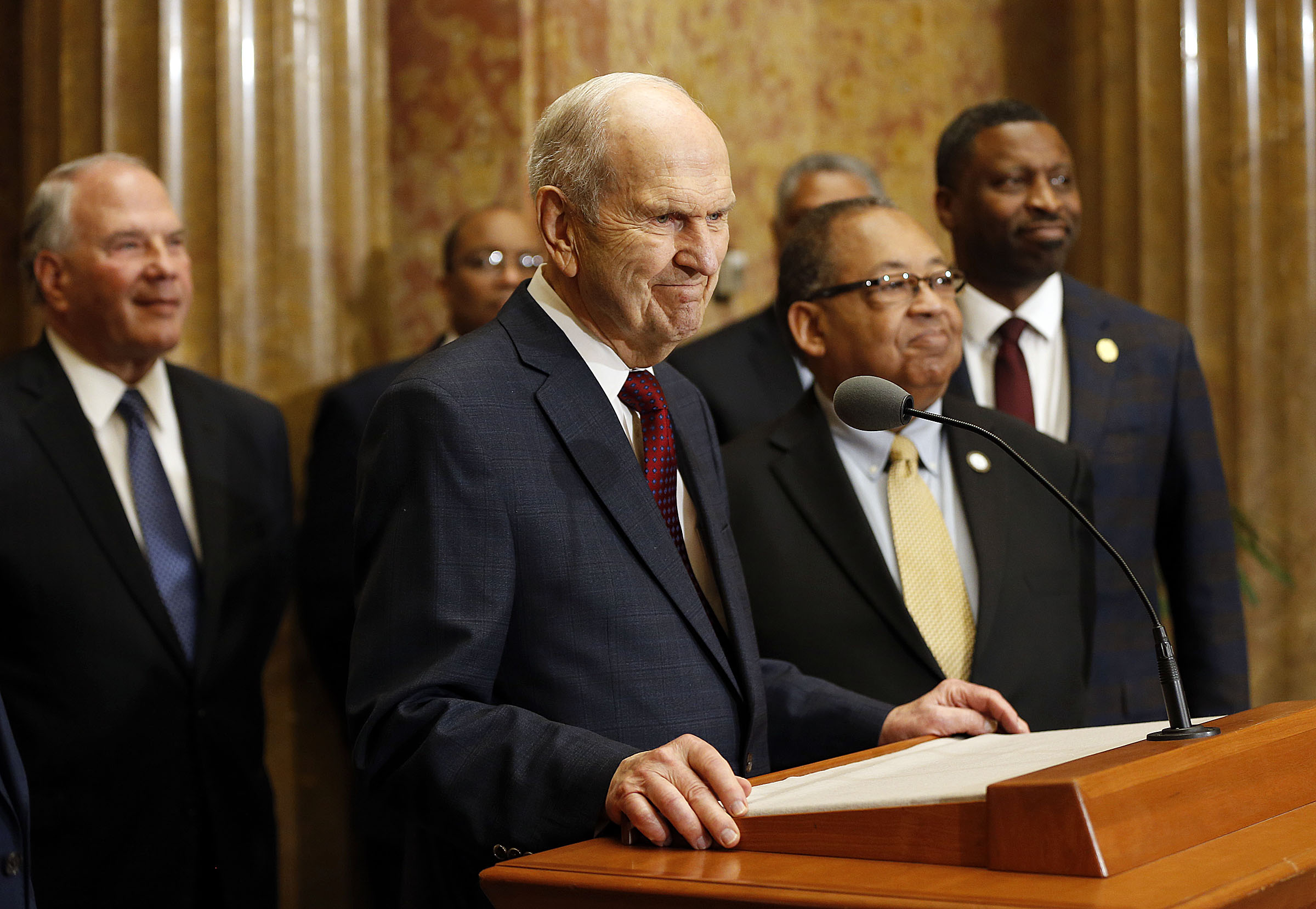 President Russell M. Nelson of The Church of Jesus Christ of Latter-day Saints speaks with national board members of the NAACP at right during a press conference in Salt Lake City on Thursday, May 17, 2018.