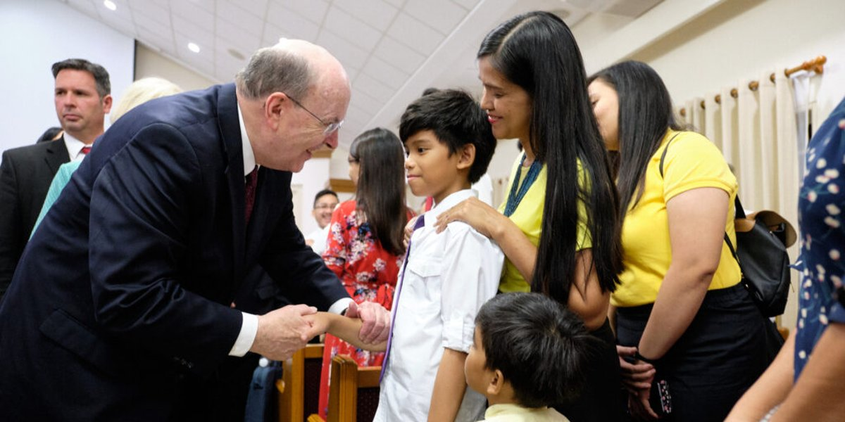 Elder Cook ministers to volcano victims in the Philippines as the country celebrates 500 years of Christianity