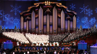The Tabernacle Choir at Temple Square sing along with performers during their opening Christmas concert at the Conference Center in Salt Lake City on Thursday, Dec. 13, 2018.