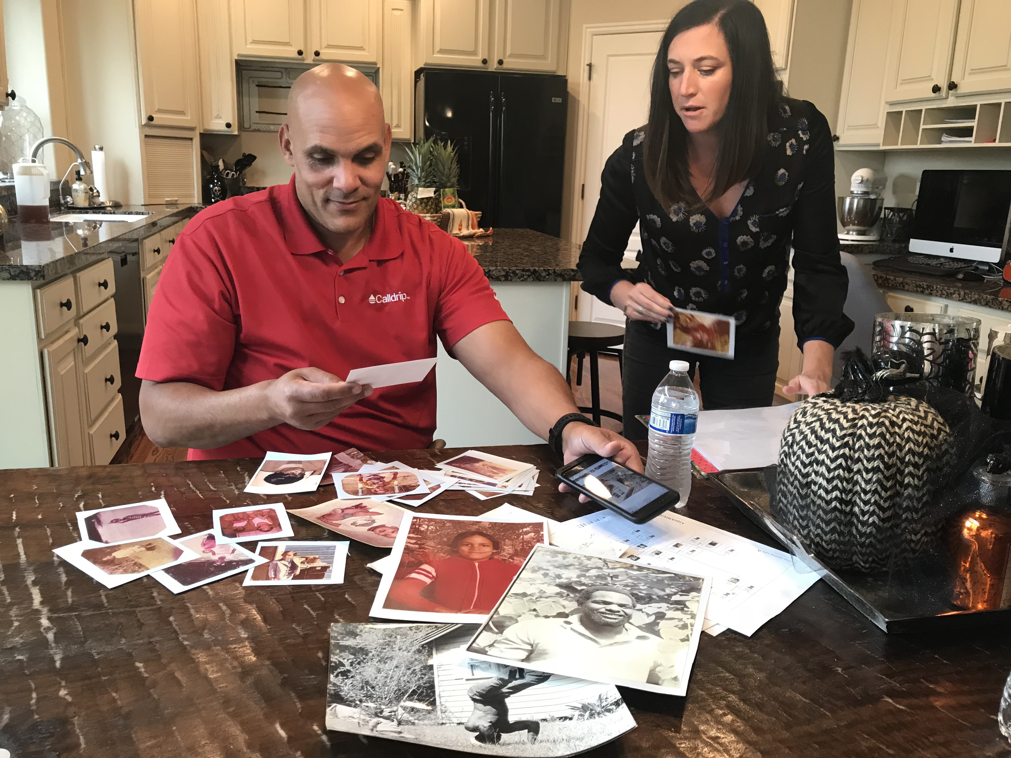 Ed and Jana Kehl look through photos of Ed as a child and old photos of his biological father, George Young.