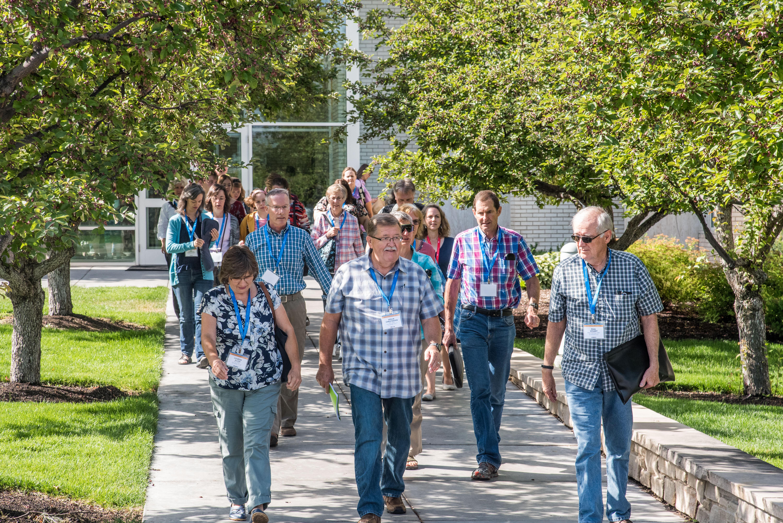 Attendees of BYU-Idaho Education Week walk across the BYU-Idaho campus.