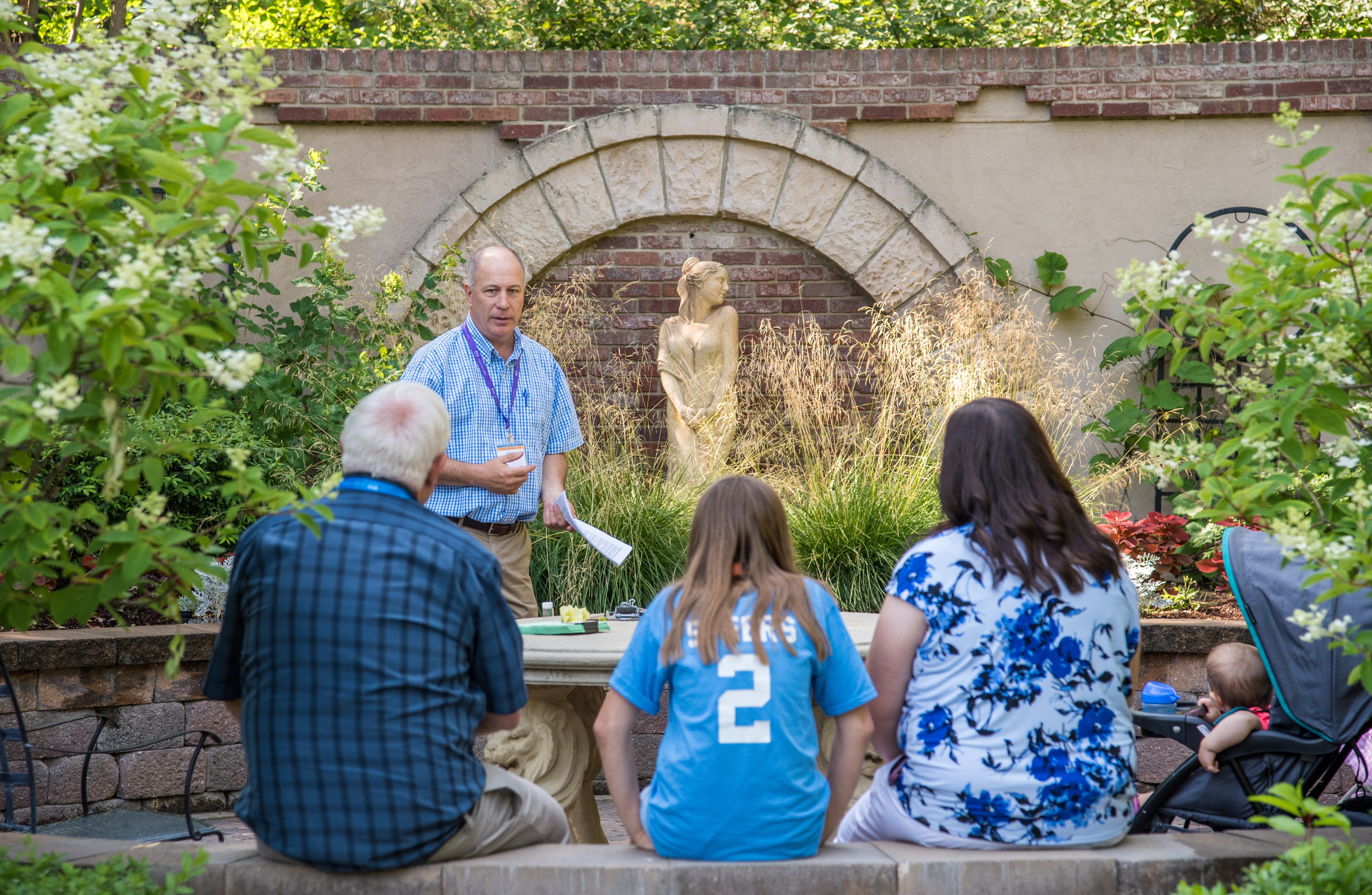Participants in BYU-Idaho Education Week take a garden tour with Reese Nelson.
