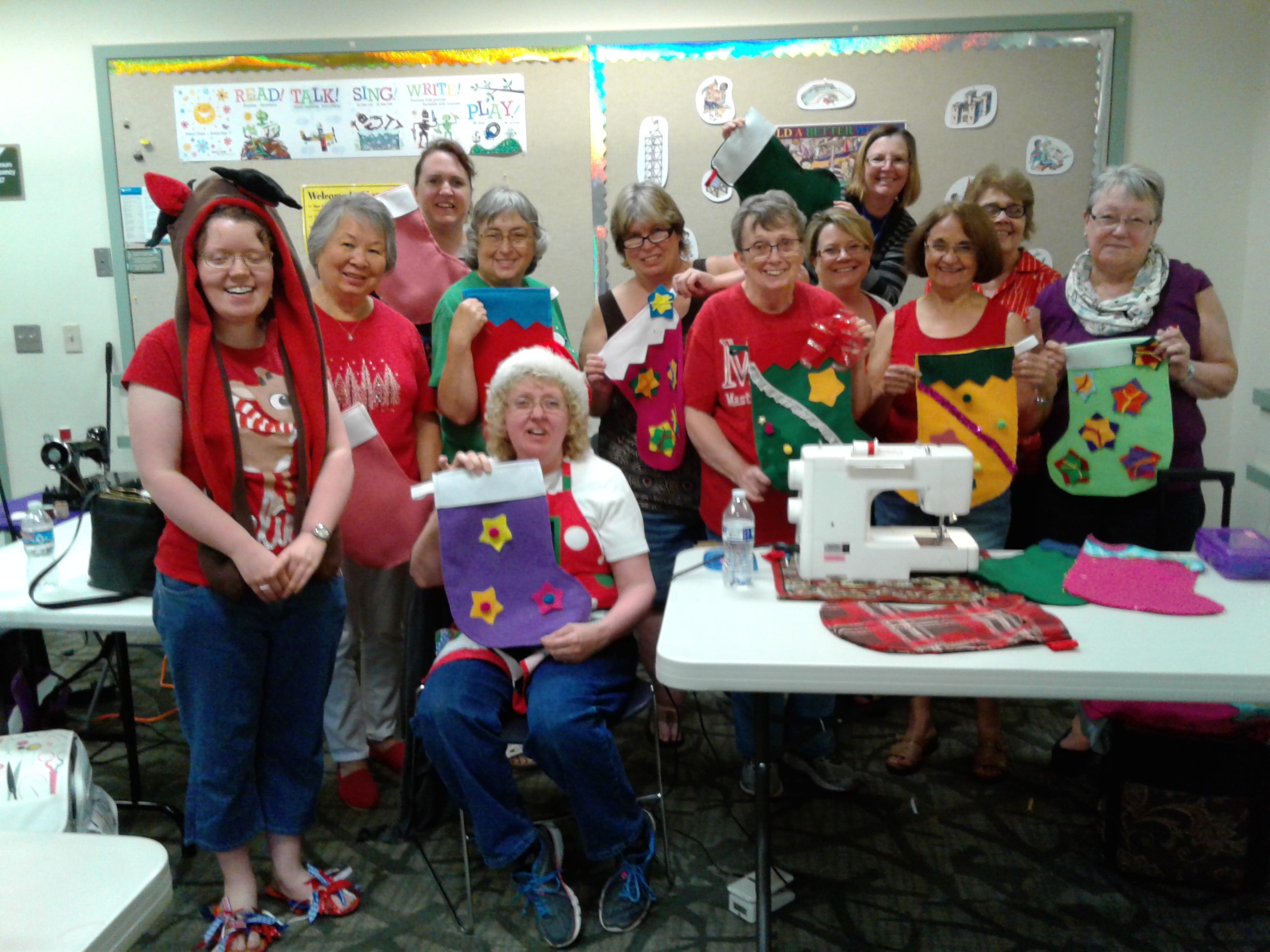 "The ""Helping Hands, Loving Hearts Sew for Community"" service group sews and decorates 300 Christmas stockings every fall for foster kids."