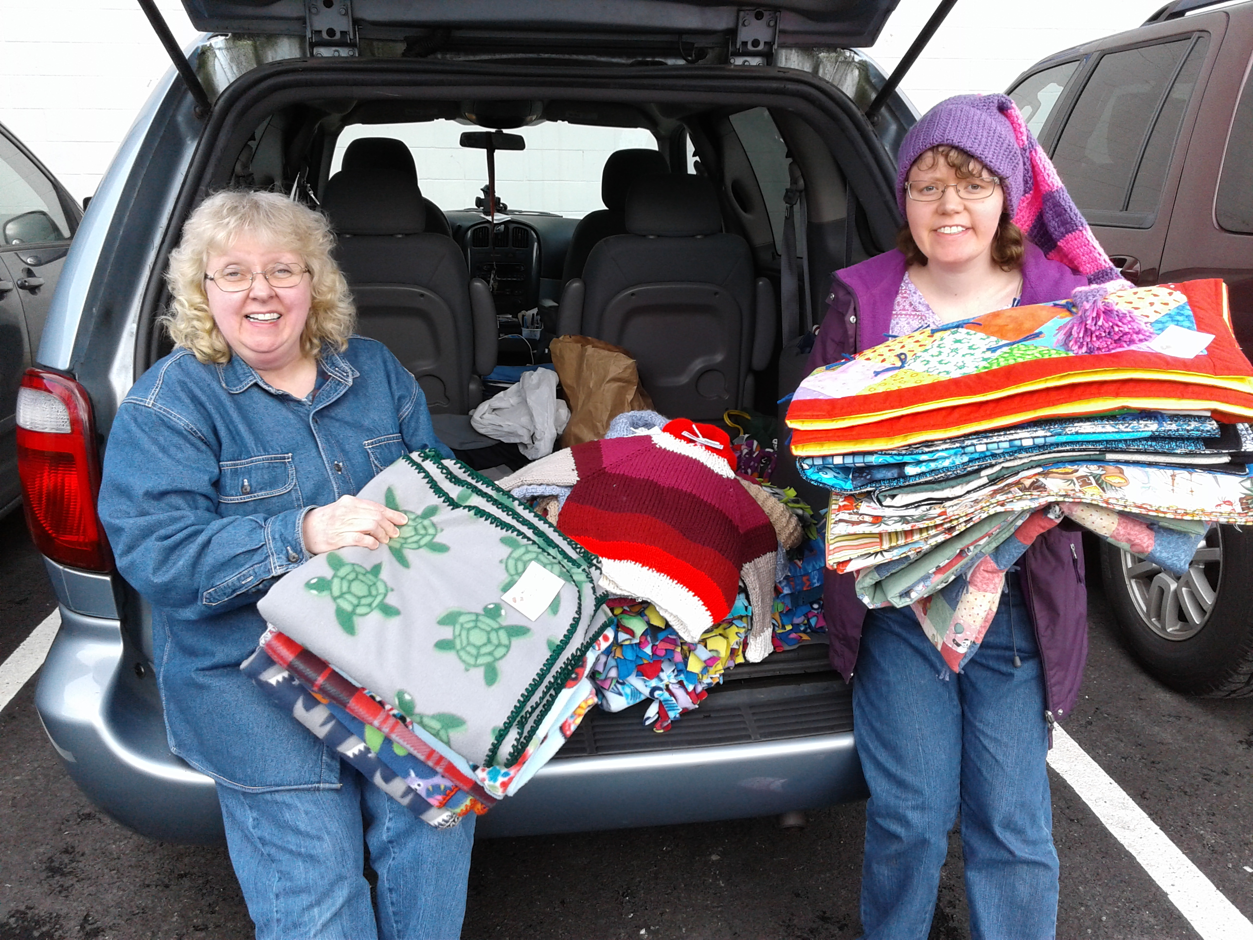 Elizabeth Thomas and Rebecca Thomas deliver handmade quilts and pillowcases to foster kids.