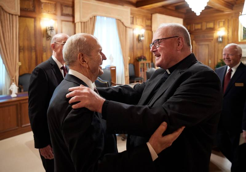 President Russell M. Nelson, left, leader of The Church of Jesus Christ of Latter-day Saints, embraces Timothy Cardinal Dolan, the Catholic archbishop of New York, in President Nelson's office in the Church Administration Building in Salt Lake City on Monday, July 1, 2019.