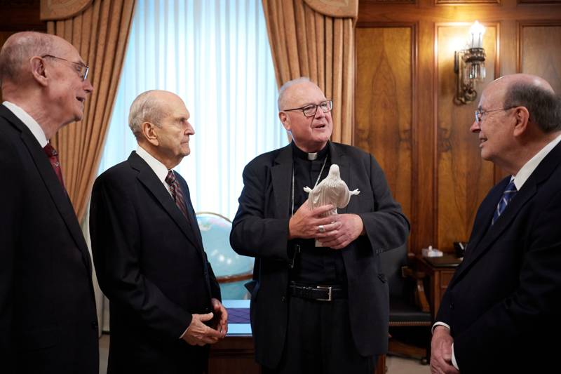 From left, President Henry B. Eyring, President Russell M. Nelson, Timothy Cardinal Dolan and Elder Quentin L. Cook talk in President Nelson's office in the Church Administration Building in Salt Lake City on Monday, July 1, 2019.